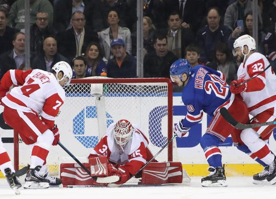 Jimmy Howard (35) of the Detroit Red Wings makes the first period save on Chris Kreider (20) of the New York Rangers at Madison Square Garden on March 19, 2019 in New York City.
