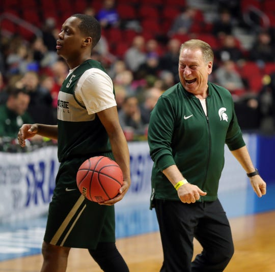 Michigan State head coach Tom Izzo is all smiles as guard Cassius Winston walks by as the team prepares for the first-round NCAA tournament game against Michigan State on Wednesday, March 20, 2019 at Wells Fargo Arena in Des Moines, Iowa.