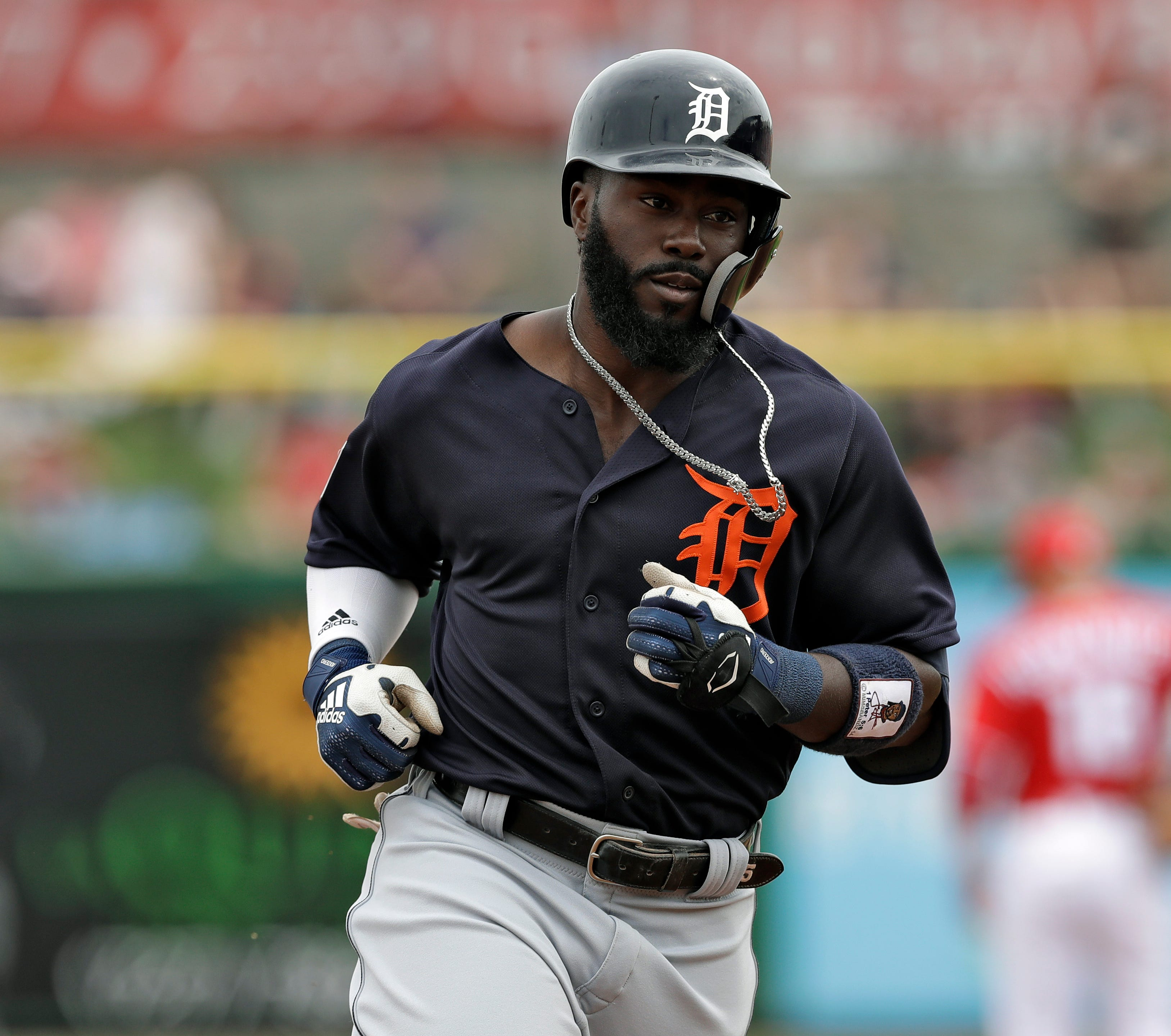 Tigers second baseman Josh Harrison runs around the bases after his home run off Philadelphia Phillies starting pitcher Nick Pivetta during the third inning of a spring training baseball game Wednesday, March 20, 2019, in Clearwater, Fla.
