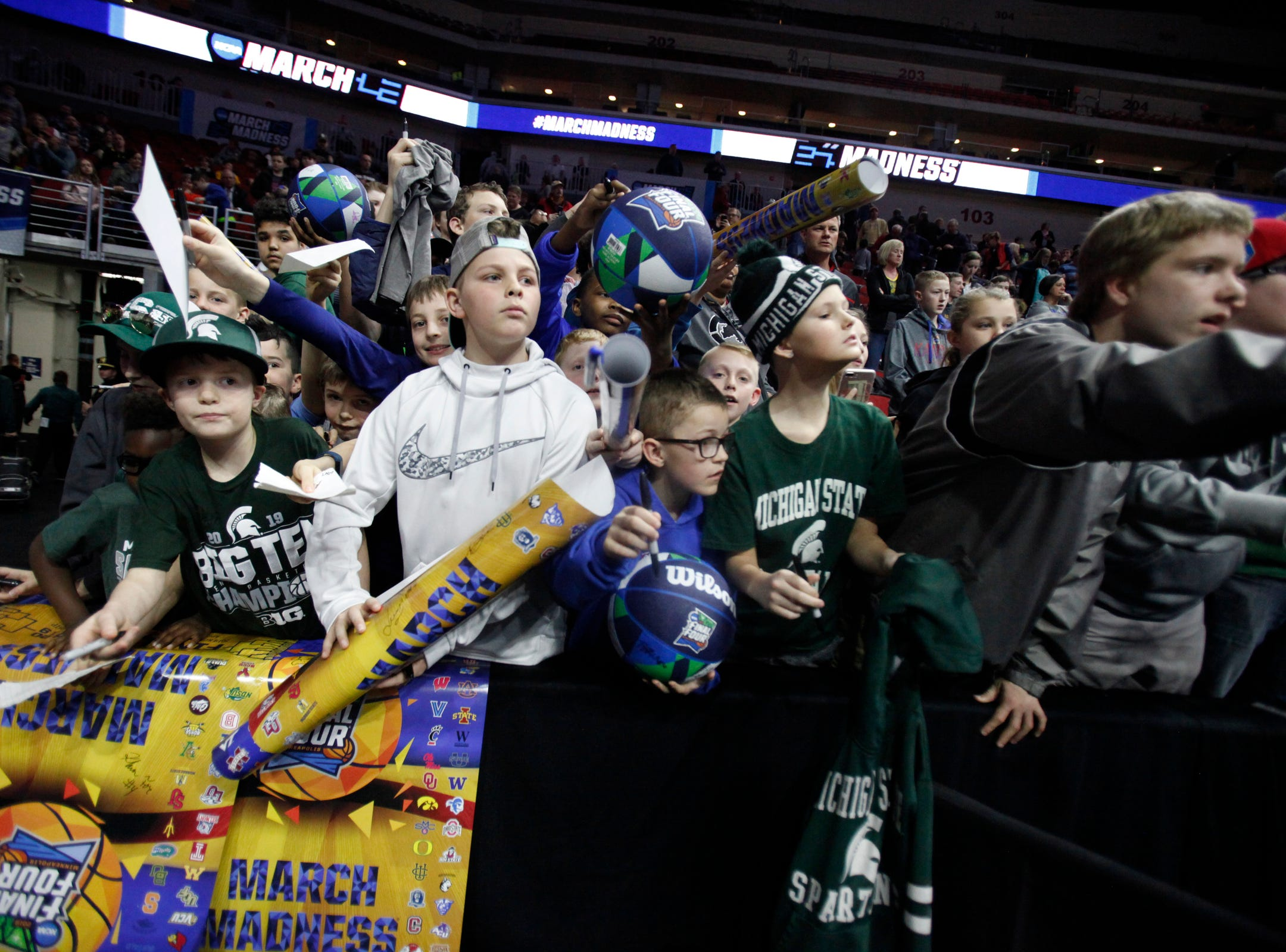 Fans wait for Michigan State players autographs after practice for the first-round NCAA tournament game against Michigan State on Wednesday, March 20, 2019 at Wells Fargo Arena in Des Moines, Iowa.