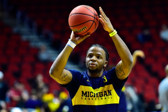 Mar 20, 2019; Des Moines, IA, USA; Michigan Wolverines guard Zavier Simpson (3) shoots the ball during practice before the first round of the 2019 NCAA Tournament at Wells Fargo Arena. Mandatory Credit: Jeffrey Becker-USA TODAY Sports