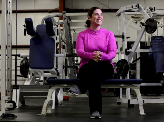 Kellie Proctor, 38 of Grosse Ile at 3D Fit in Riverview, Michigan on Saturday, March 16, 2019. Proctor frequently works out at 3D Fit and hasn't allowed her recent knee replacement surgery to stop her from being physically active.