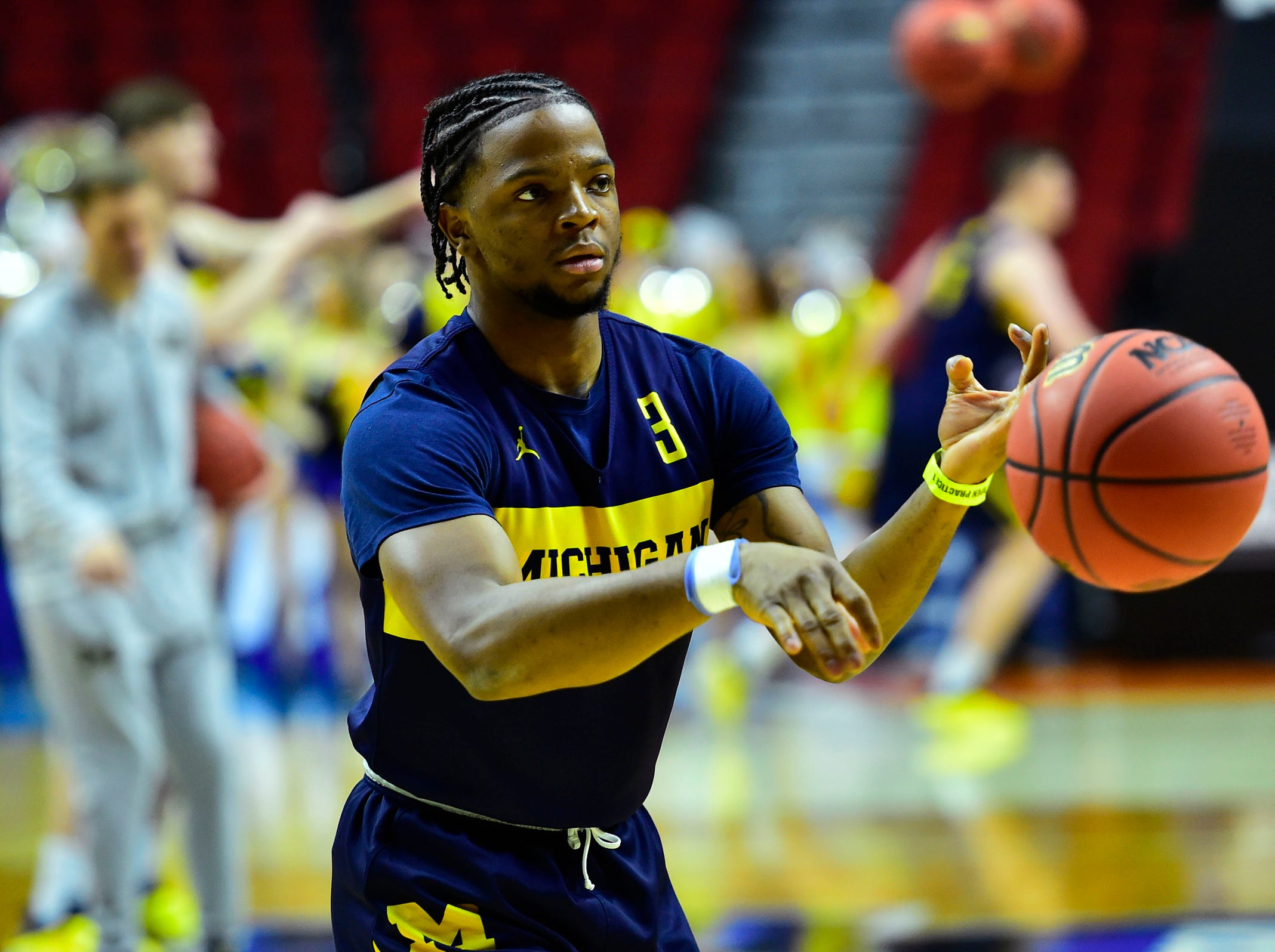 Mar 20, 2019; Des Moines, IA, USA; Michigan Wolverines guard Zavier Simpson (3) passes the ball during practice before the first round of the 2019 NCAA Tournament at Wells Fargo Arena. Mandatory Credit: Jeffrey Becker-USA TODAY Sports