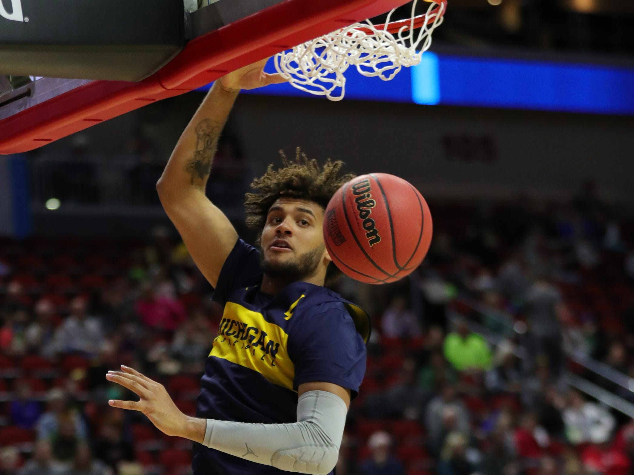 Michigan forward Isaiah Livers dunks during practice for their first round NCAA Tournament game against Montana Wednesday, March 20, 2019 at Wells Fargo Arena in Des Moines, Iowa.