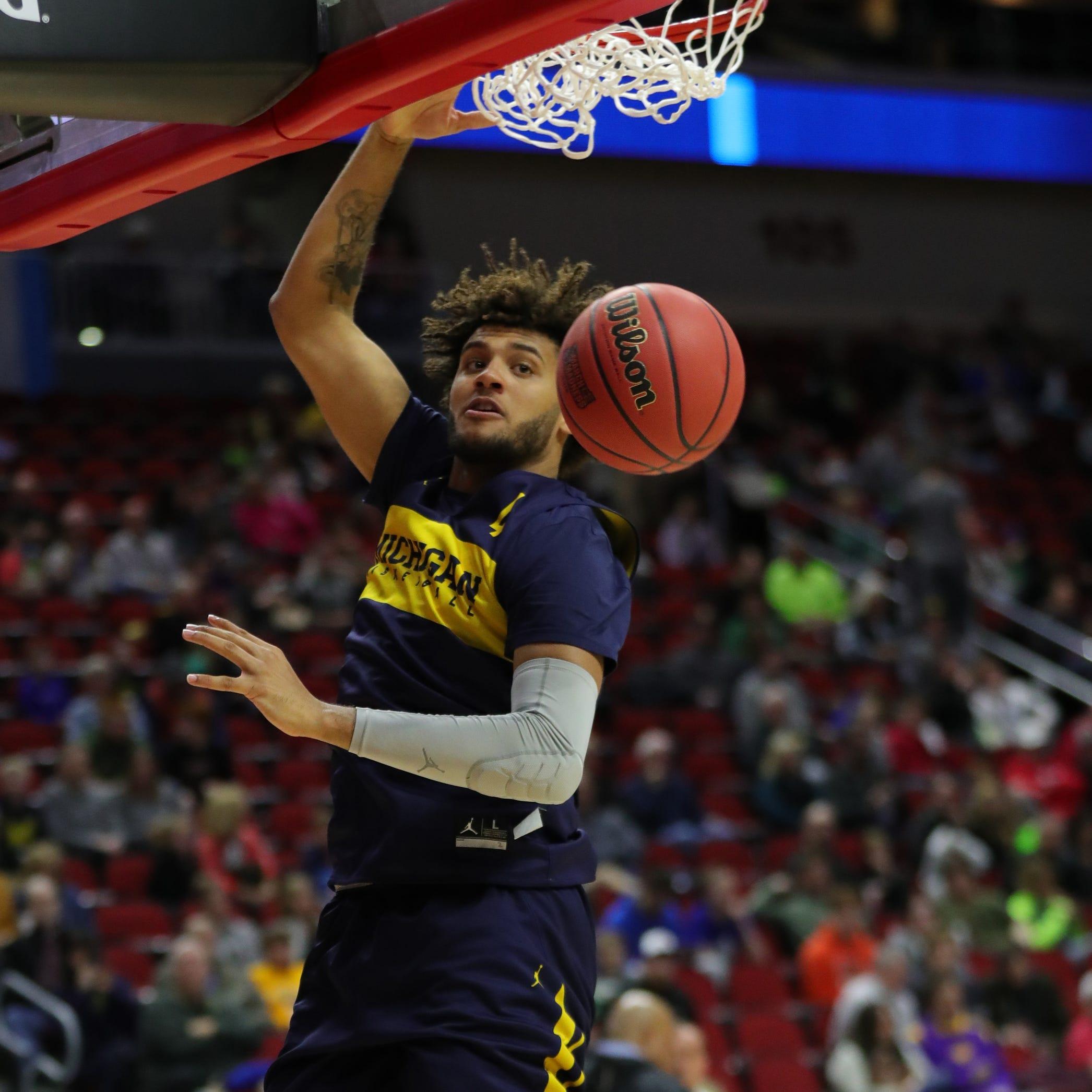 Michigan forward Isaiah Livers dunks during...