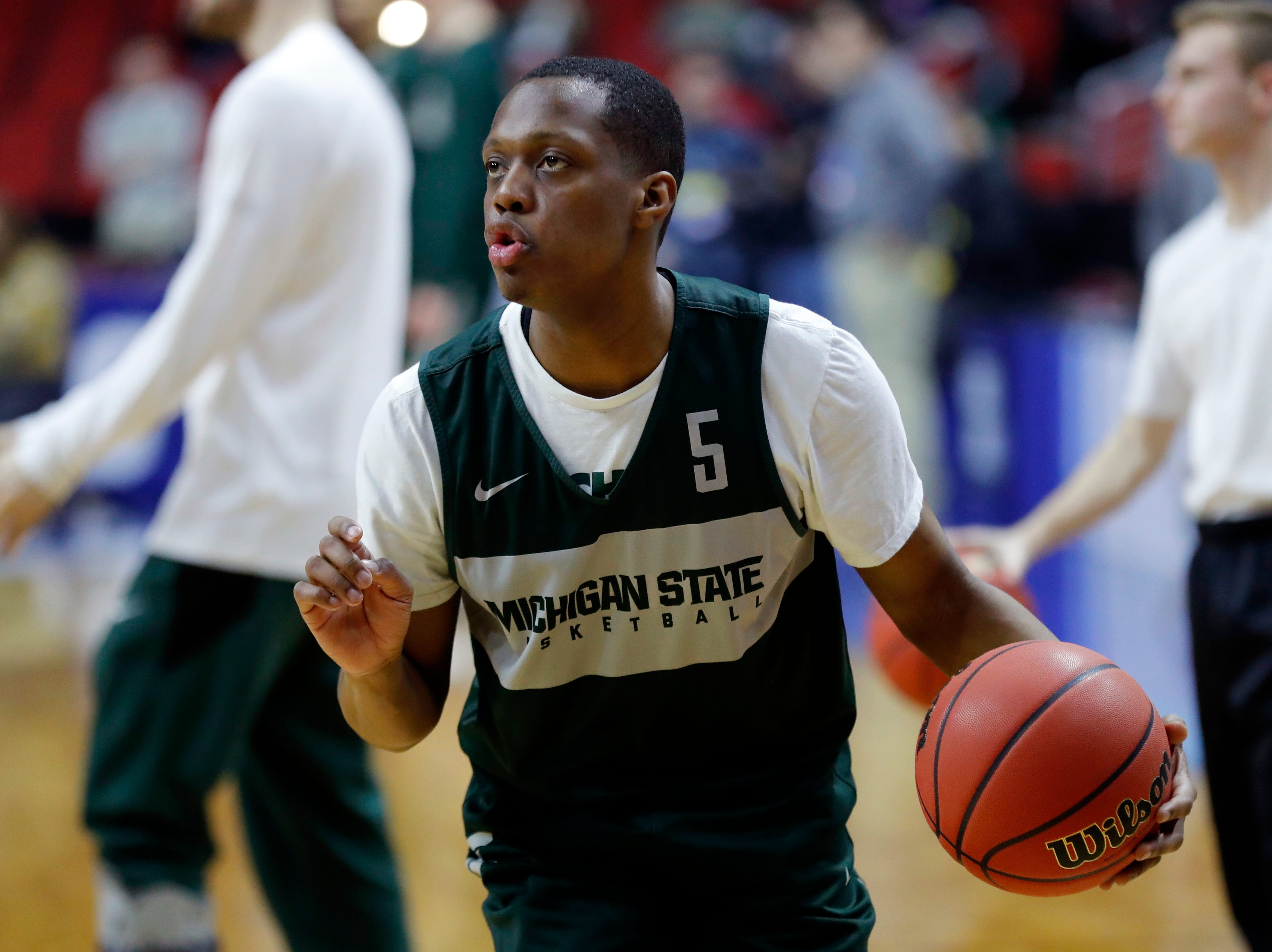 Michigan State guard Cassius Winston drives up court during practice at the NCAA men's college basketball tournament, Wednesday, March 20, 2019, in Des Moines, Iowa. Michigan State plays Bradley on Thursday. (AP Photo/Charlie Neibergall)