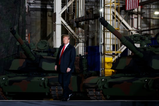 President Donald Trump arrives to deliver remarks at the Lima Army Tank Plant, Wednesday, March 20, 2019, in Lima, Ohio. (AP Photo/Evan Vucci)