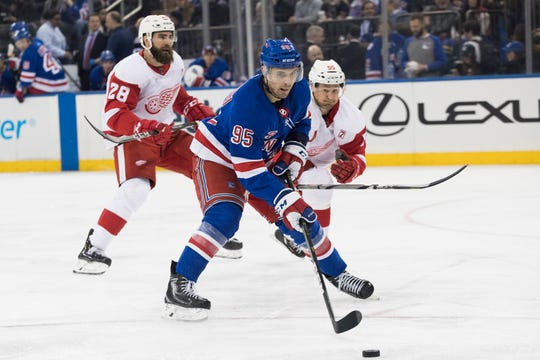 New York Rangers center Vinni Lettieri (95) controls the puck skating against Detroit Red Wings right wing Luke Witkowski (28) and defenseman Niklas Kronwall (55) during the second period of an NHL hockey game, Tuesday, March 19, 2019, at Madison Square Garden in New York.