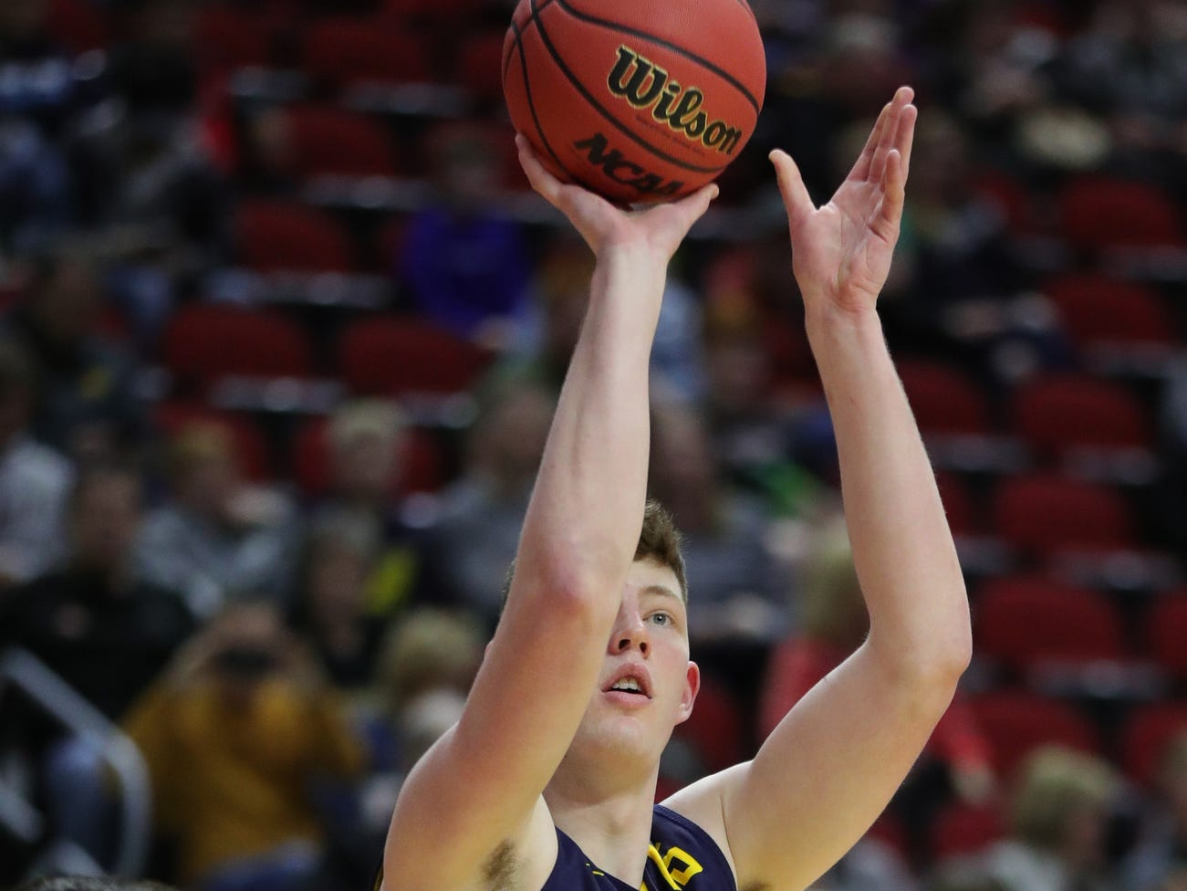 Michigan center Jon Teske shoots jumpers during practice for their first round NCAA Tournament game against Montana Wednesday, March 20, 2019 at Wells Fargo Arena in Des Moines, Iowa.