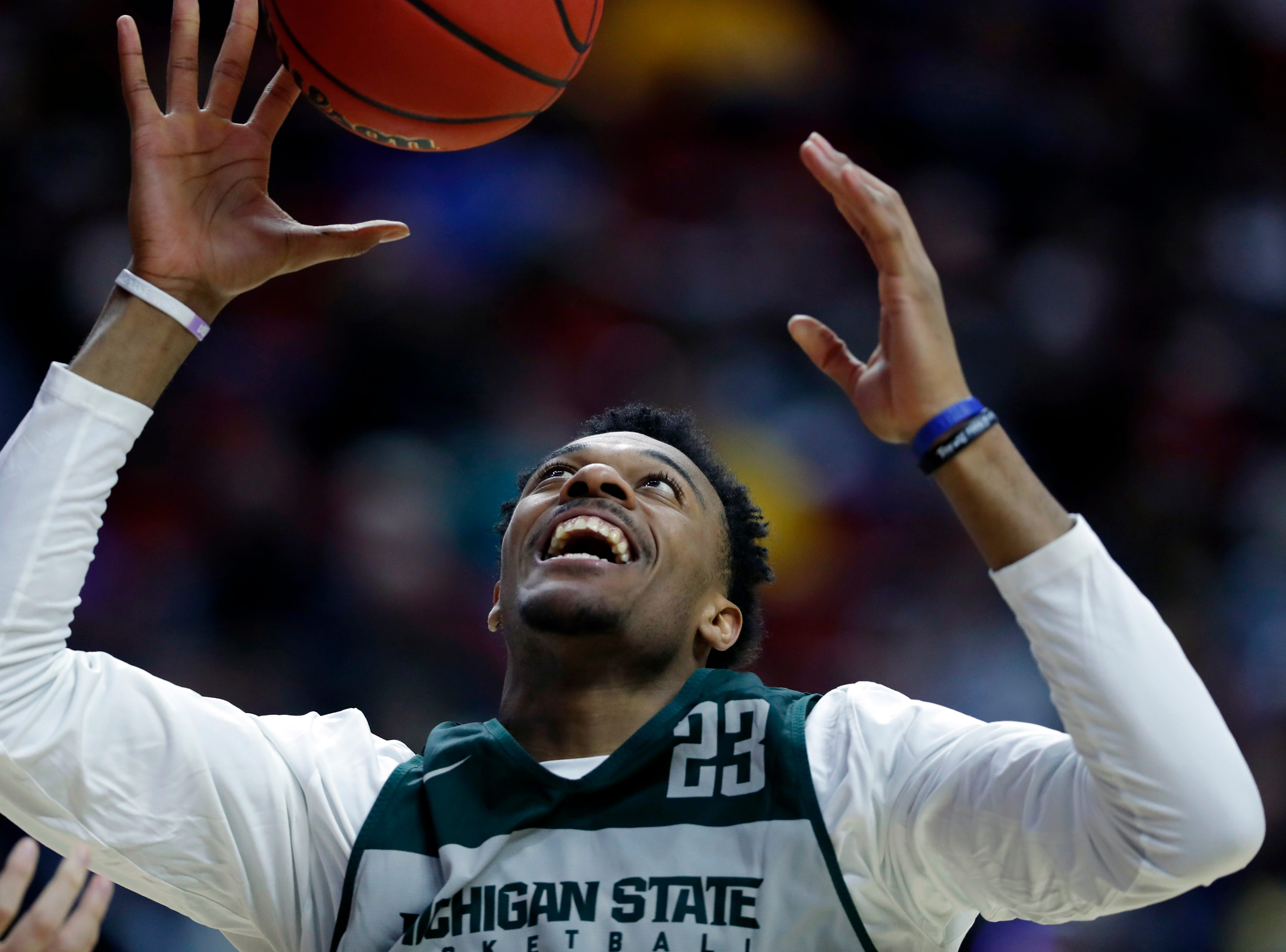 Michigan State forward Xavier Tillman catches a pass during practice at the NCAA men's college basketball tournament, Wednesday, March 20, 2019, in Des Moines, Iowa. Michigan State plays Bradley on Thursday. (AP Photo/Charlie Neibergall)