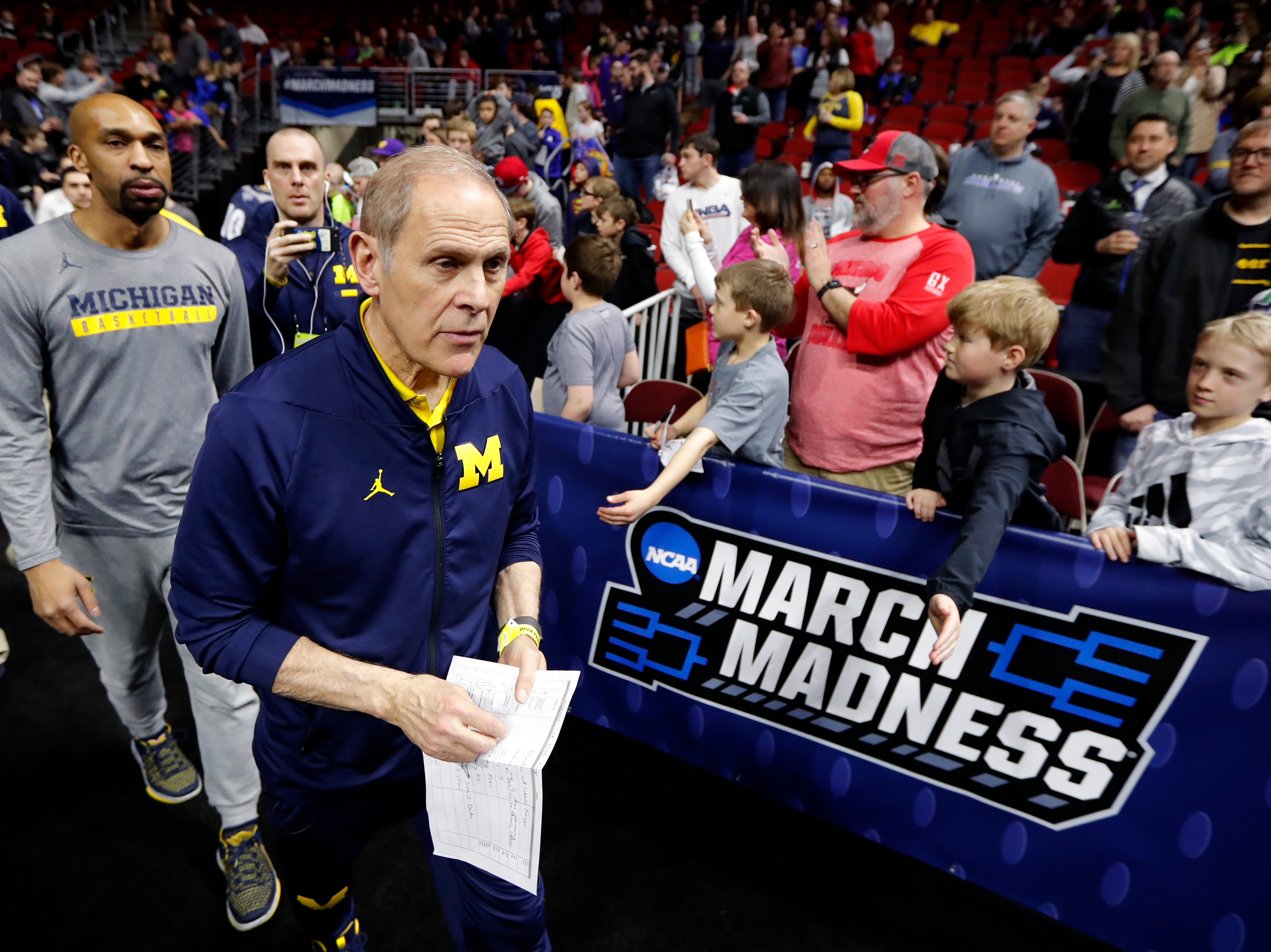 Michigan head coach John Beilein walks to the court for practice at the NCAA men's college basketball tournament, Wednesday, March 20, 2019, in Des Moines, Iowa. Michigan plays Montana on Thursday. (AP Photo/Charlie Neibergall)