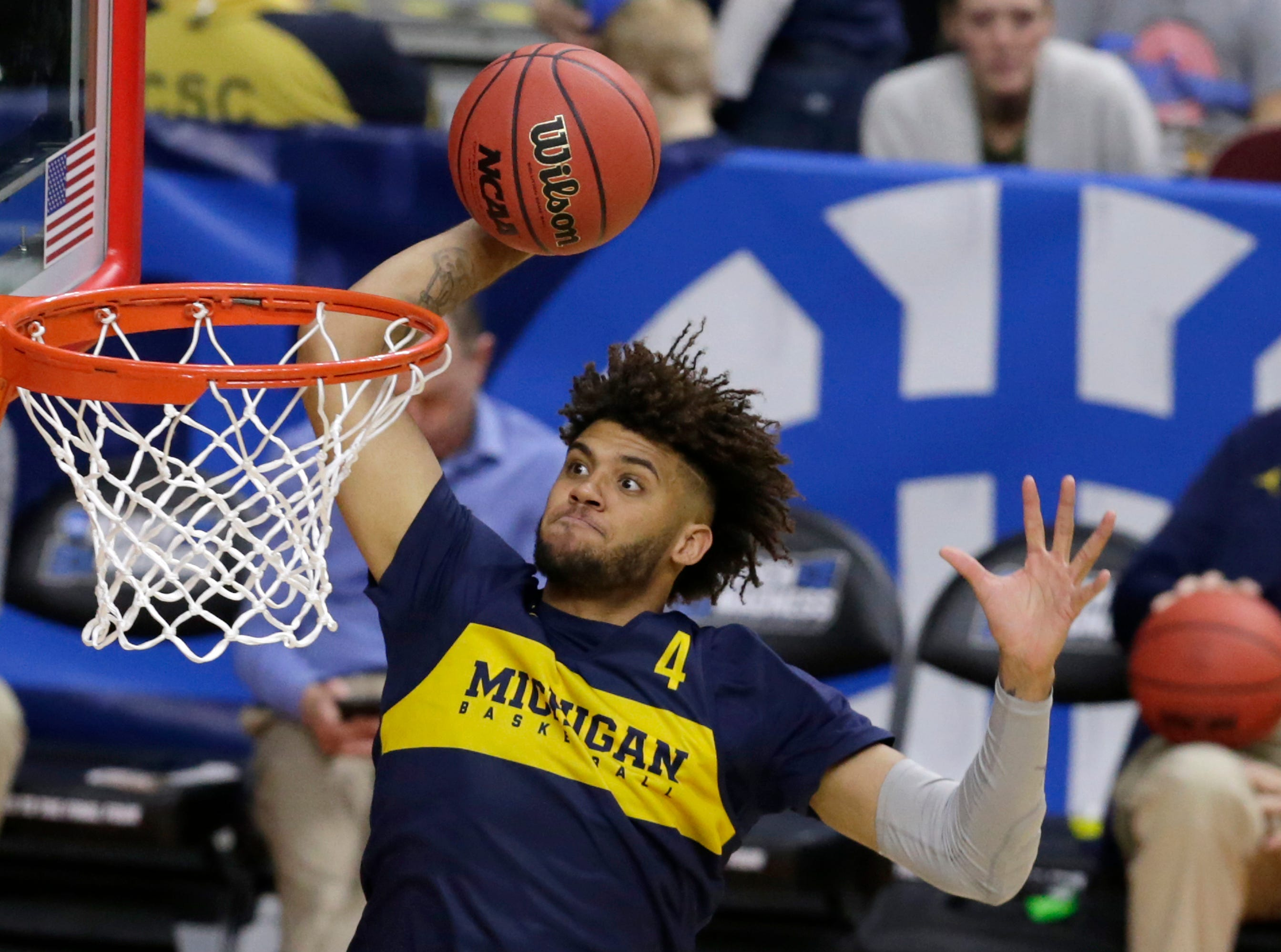 Michigan's Isaiah Livers (4) dunks during practice at the NCAA college basketball tournament in Des Moines, Iowa, Wednesday, March 20, 2019. (AP Photo/Nati Harnik)