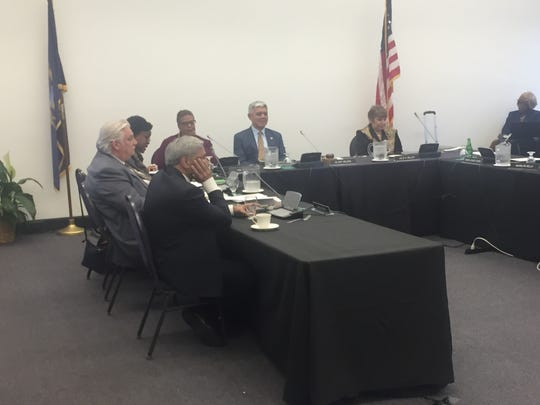 Wayne State University President M. Roy Wilson (center) listens as board members discuss his performance during a board meeting on March 20, 2019.