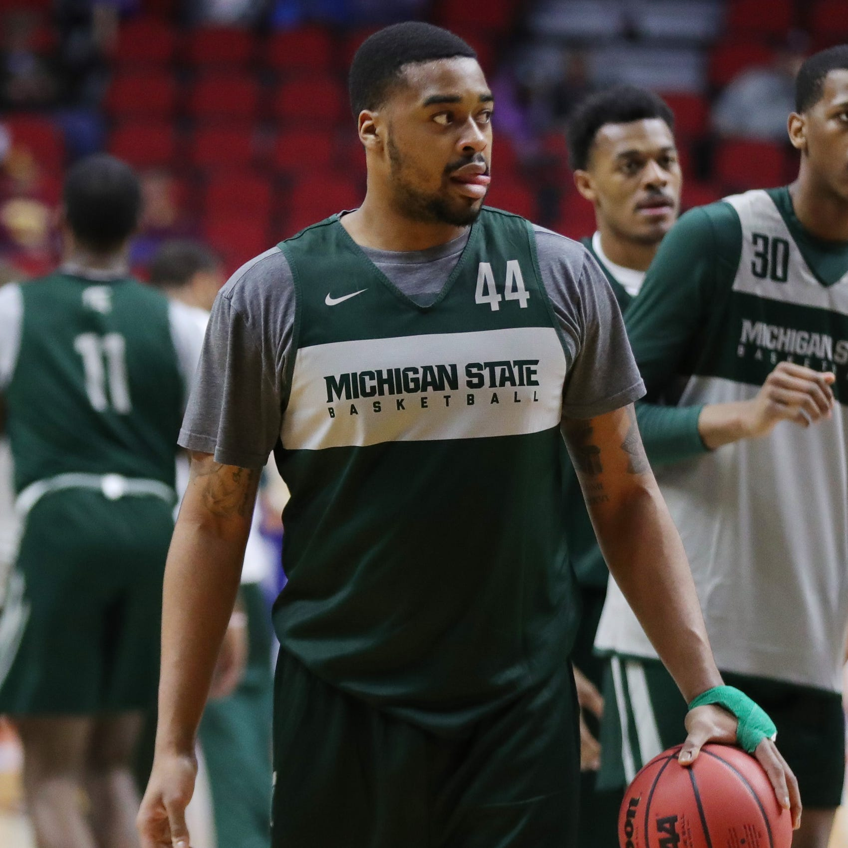 Michigan State's Nick Ward: Catching ball with hand brace ain't easy