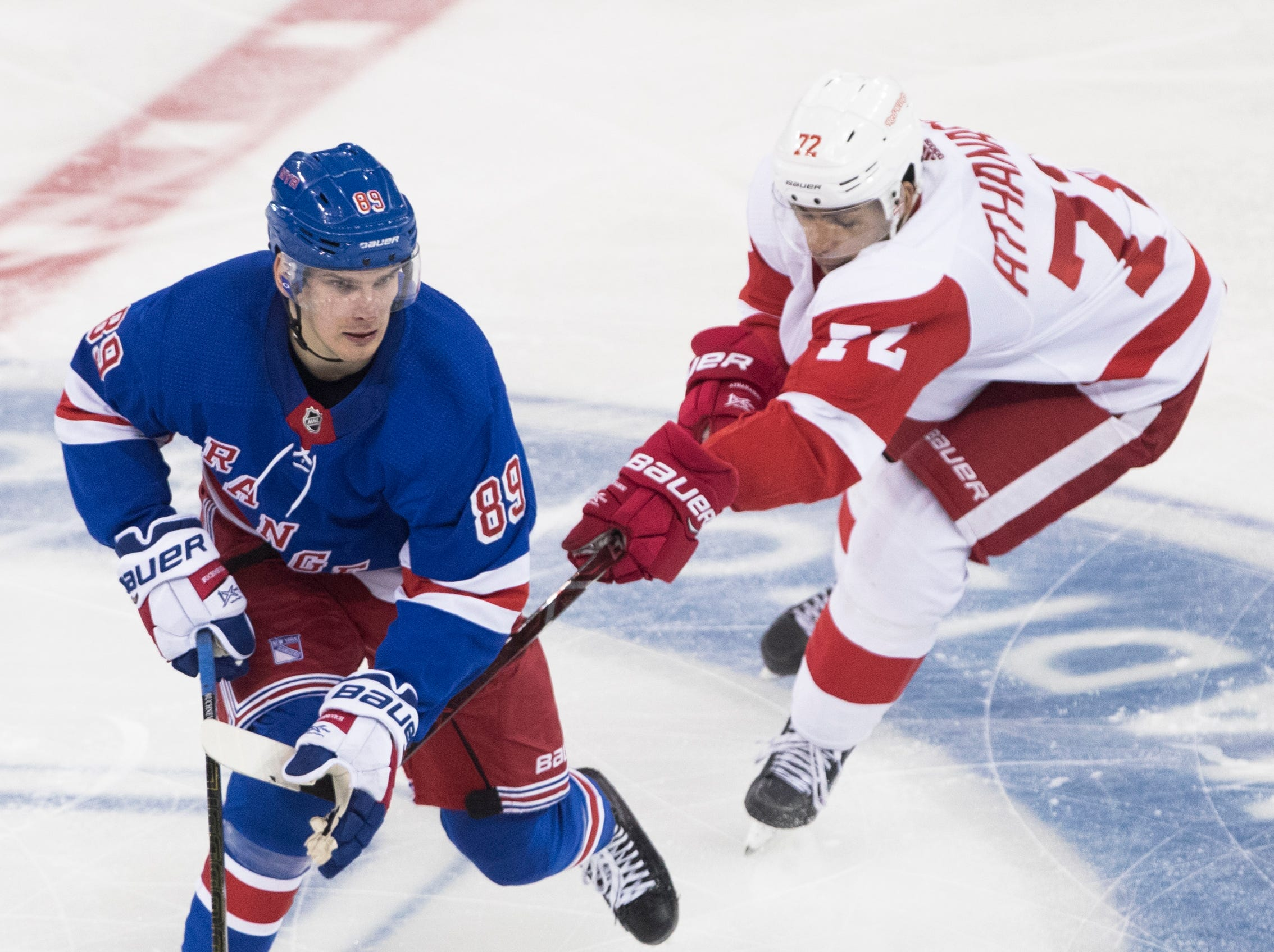 New York Rangers right wing Pavel Buchnevich (89) skates against Detroit Red Wings center Andreas Athanasiou (72) during the third period.