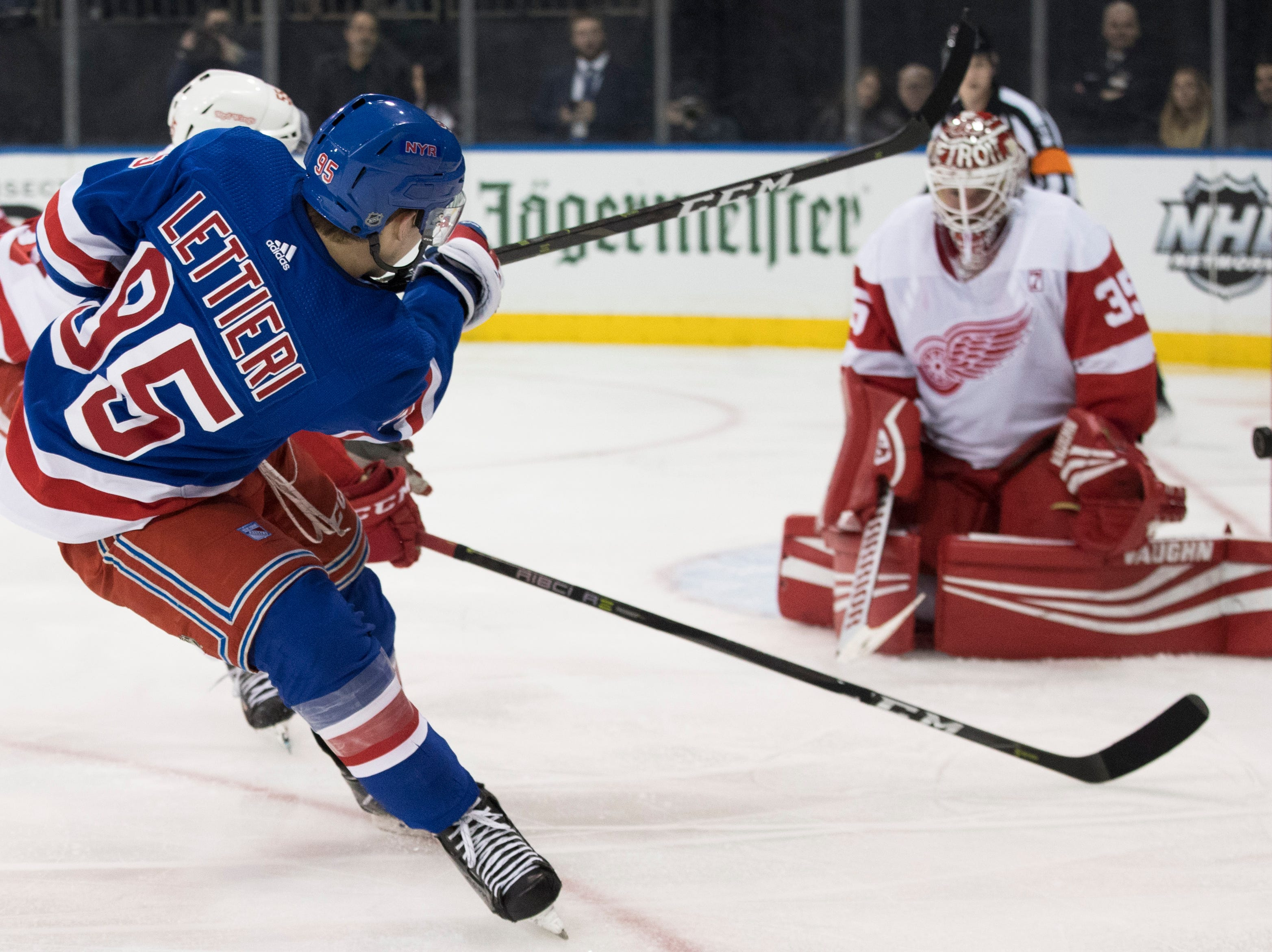 Detroit Red Wings goaltender Jimmy Howard (35) makes the save against New York Rangers center Vinni Lettieri (95) during the second period.