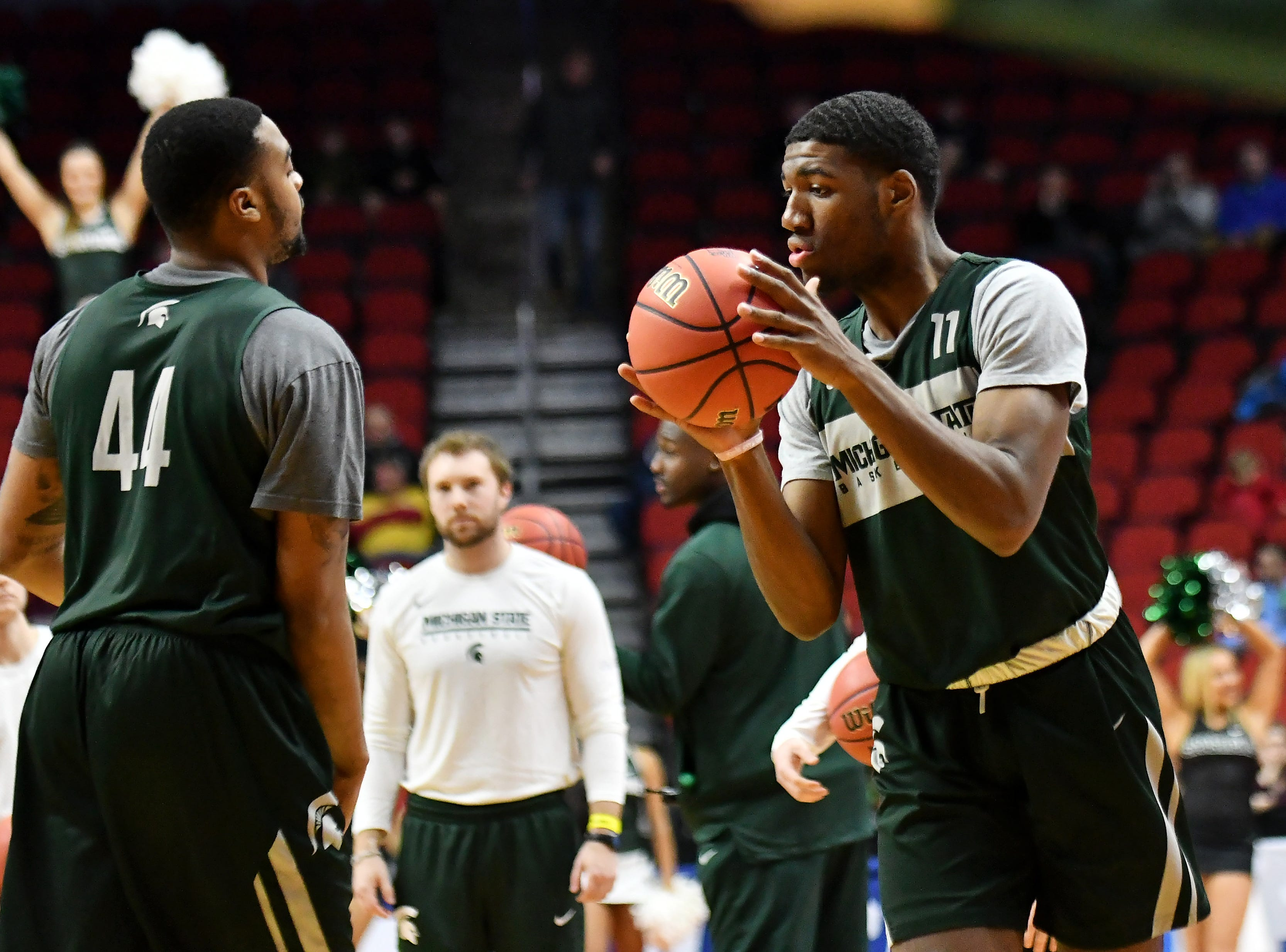 Michigan State forward Aaron Henry (11) participates in a passing drill during practice.