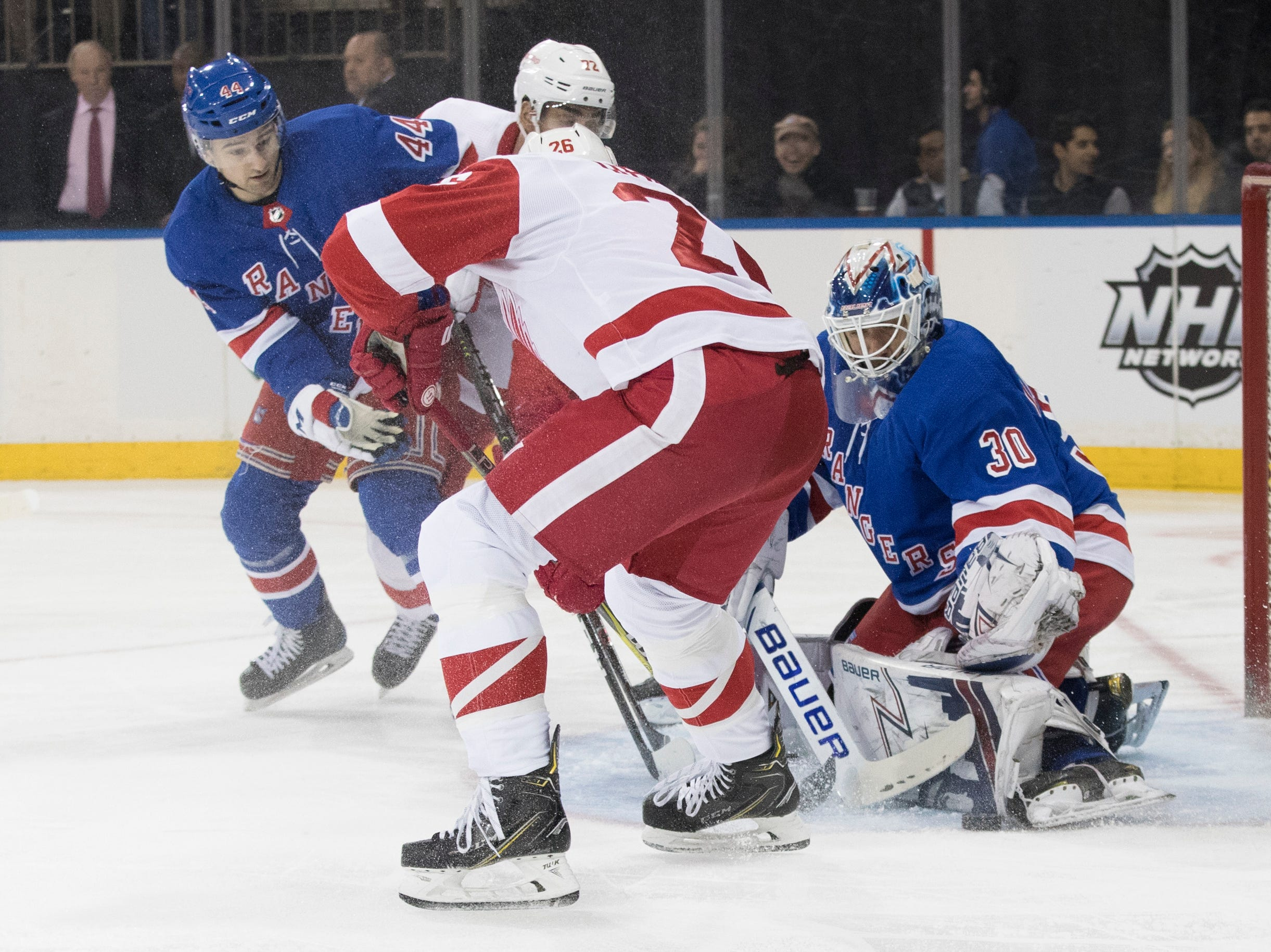 New York Rangers goaltender Henrik Lundqvist (30) makes the save against Detroit Red Wings left wing Thomas Vanek (26) during the first period.