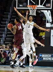 Michigan guard Charles Matthews (1) guards Montana guard Ahmaad Rorie (14) in the second half of last year's first-round game in the NCAA Tournament.