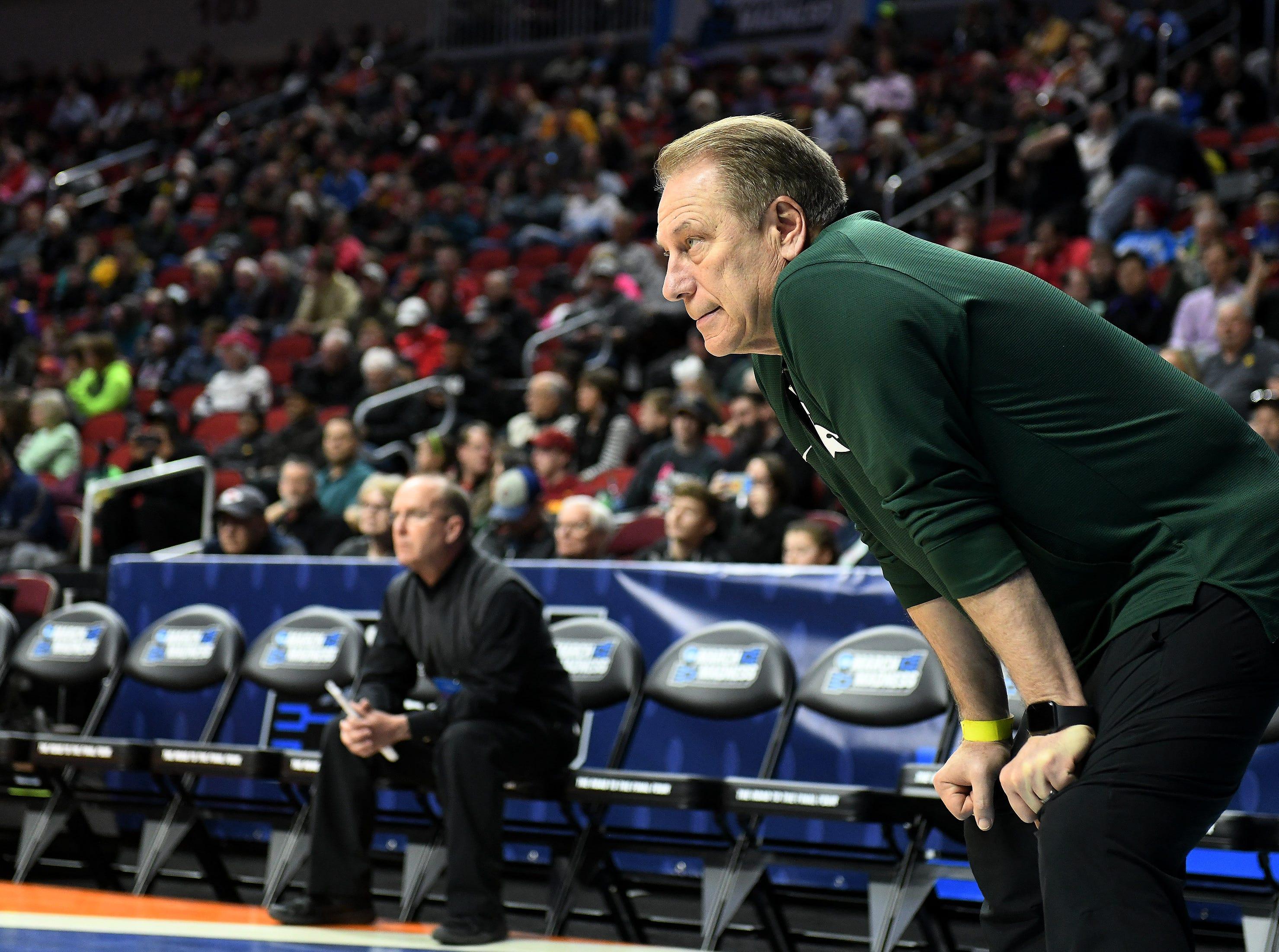 Michigan State head coach Tom Izzo watches.