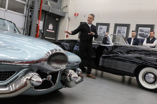Bob Boniface, Buick director of design, explains inspirational design elements from ground-breaking 1938 Buick Y Job concept, right, and the 1951 Buick Le Sabre concept.
