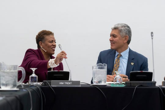 Wayne State University Board of Governors chair Kim Trent, left, and president Roy Wilson chat before the start of a Board of Governors meeting at Wayne State University.
