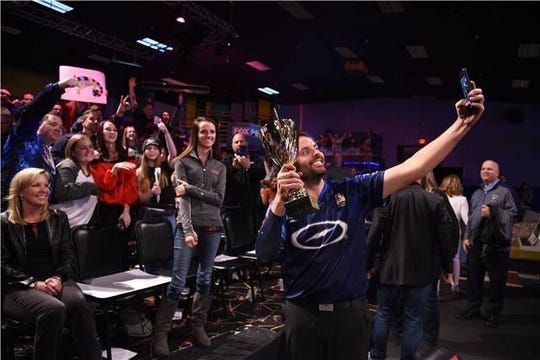 Jason Belmonte takes a selfie with fans in Allen Park on Tuesday night.