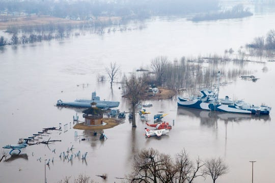 Freedom Park, the naval museum featuring aircraft, the USS Marlin SST-2 Submarine and the USS Hazard AM-240 Minesweeper, is flooded by the waters of the Missouri River, in Omaha, Neb., Tuesday, March 19, 2019.