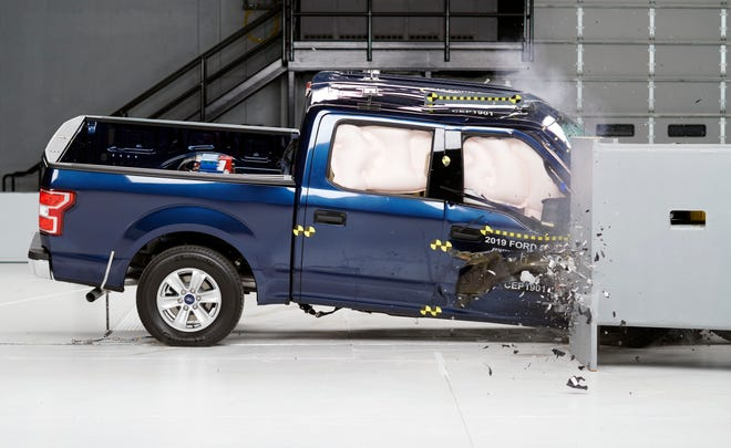 The 2019 Ford F-150 SuperCrew undergoes the passenger-side small overlap frontal crash test.  The Ford F-150 was the best  performer among pickups in the front passenger protection test.
