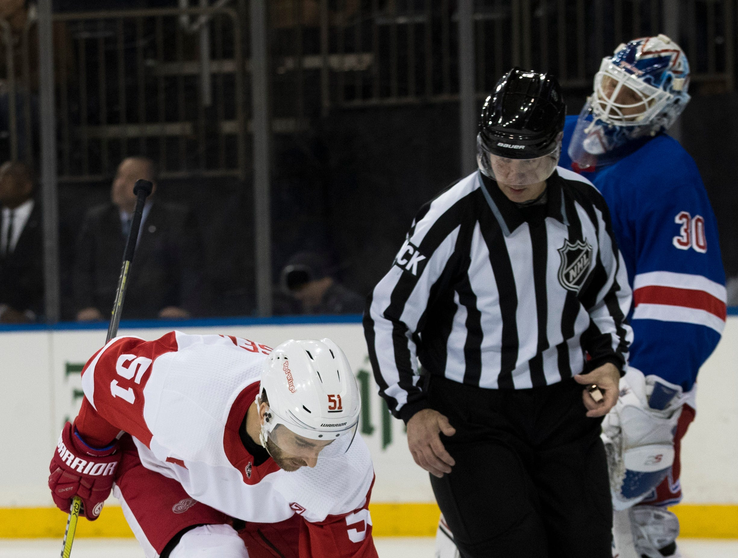 Detroit Red Wings center Frans Nielsen (51) picks up the puck after scoring a goal past New York Rangers goaltender Henrik Lundqvist (30) during the first period.