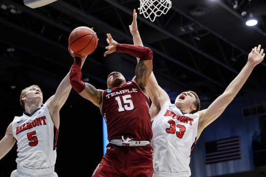 Belmont's Adam Kunkel (5) blocks a shot by Temple's Nate Pierre-Louis (15) during the second half Tuesday. Belmont won 81-70.