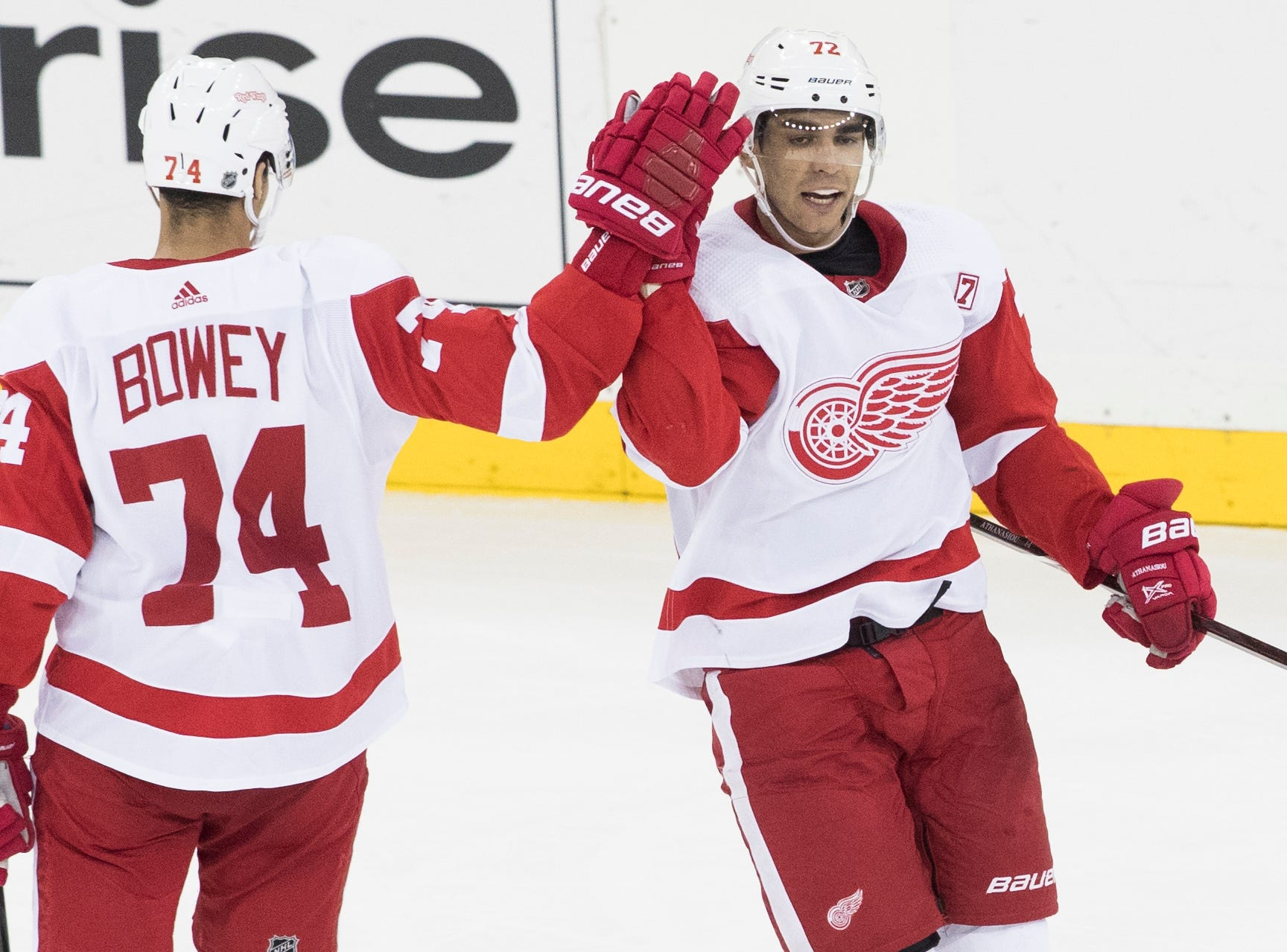 Detroit Red Wings center Andreas Athanasiou (72) celebrates after scoring the winning goal with defenseman Madison Bowey (74) during the third period of an NHL hockey game against the New York Rangers, Tuesday, March 19, 2019, at Madison Square Garden in New York. The Red Wings won 3-2.