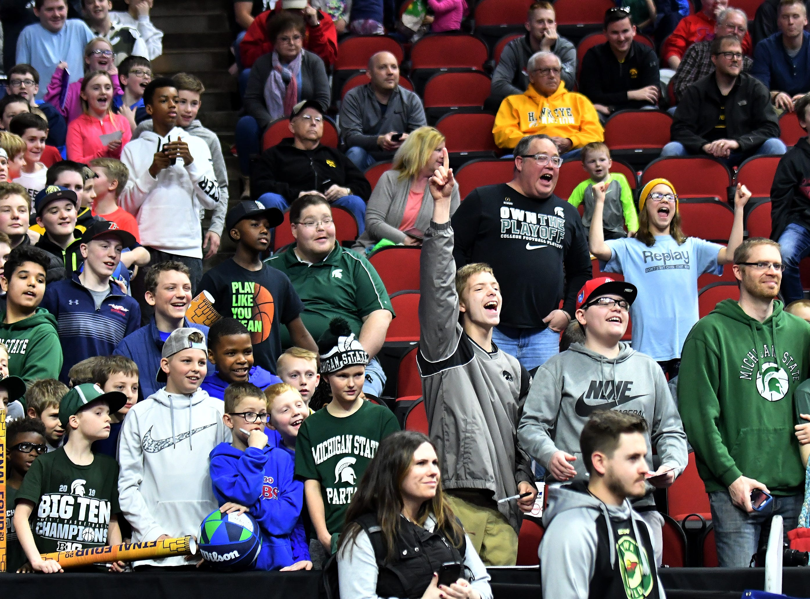 Michigan State fans watch the Spartans practice in Des Moines, Iowa.