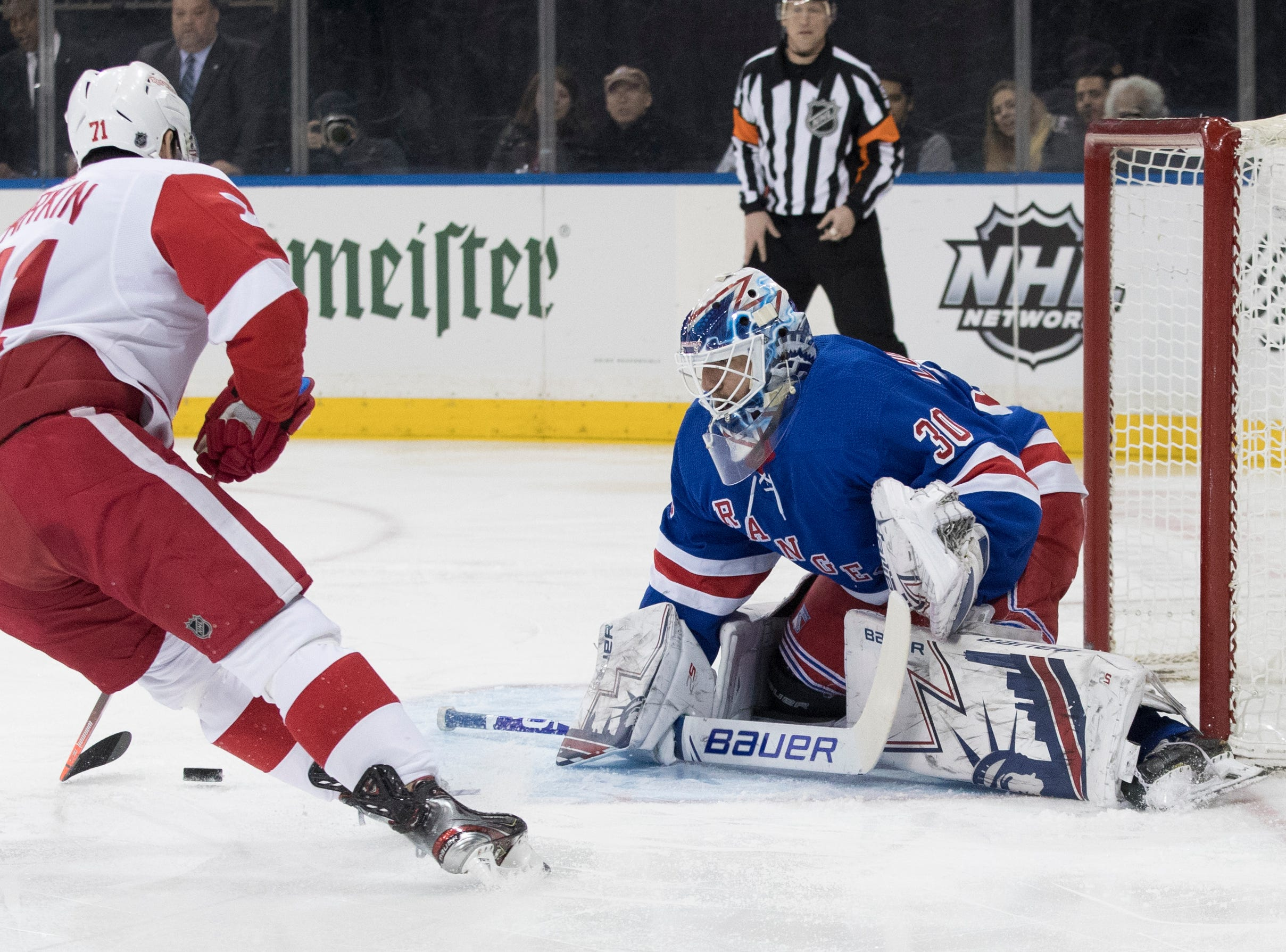 New York Rangers goaltender Henrik Lundqvist (30) makes the save against Detroit Red Wings center Dylan Larkin (71) during the first period.