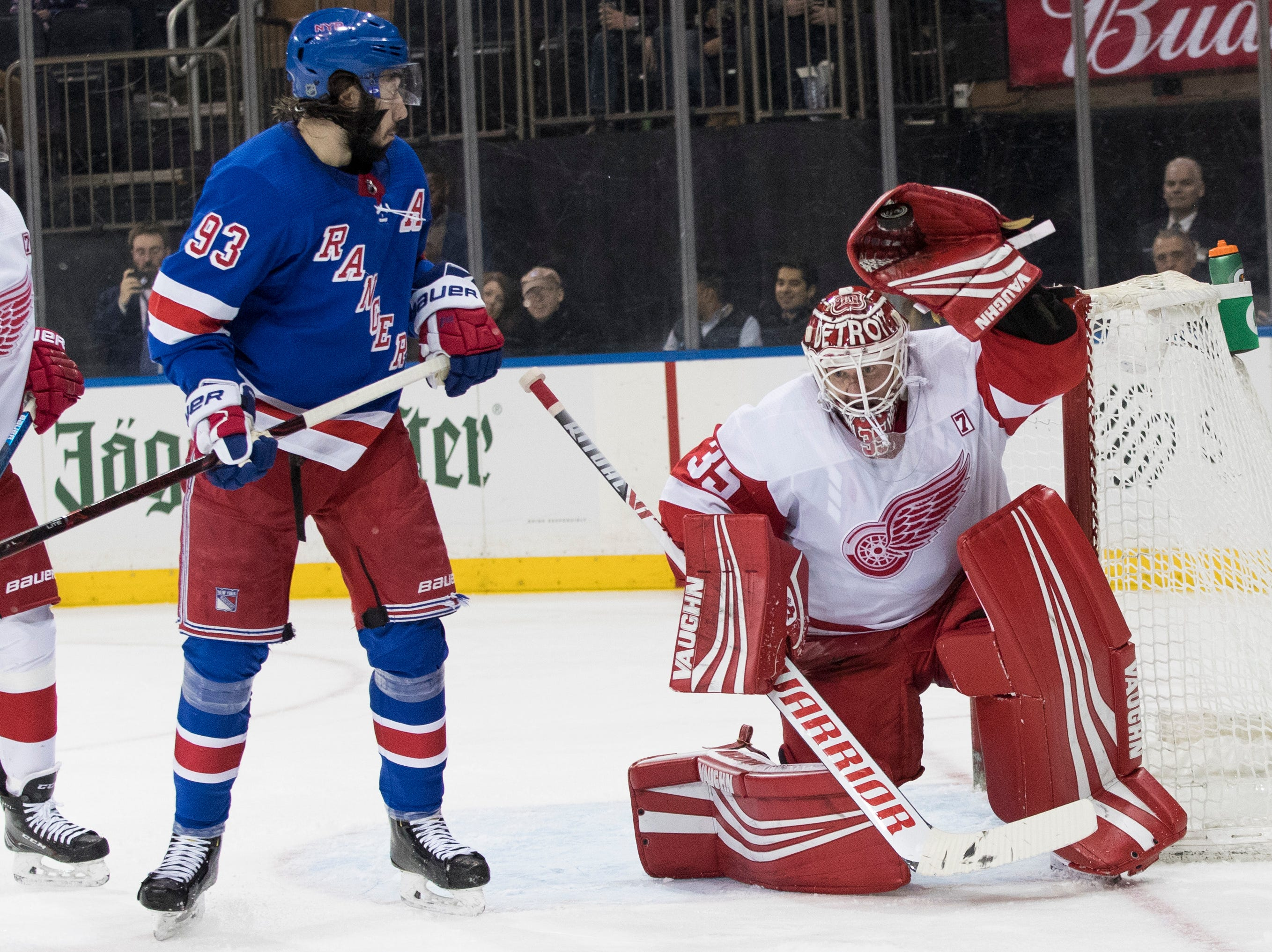 Detroit Red Wings goaltender Jimmy Howard (35) makes the save against New York Rangers center Mika Zibanejad (93) during the second period.