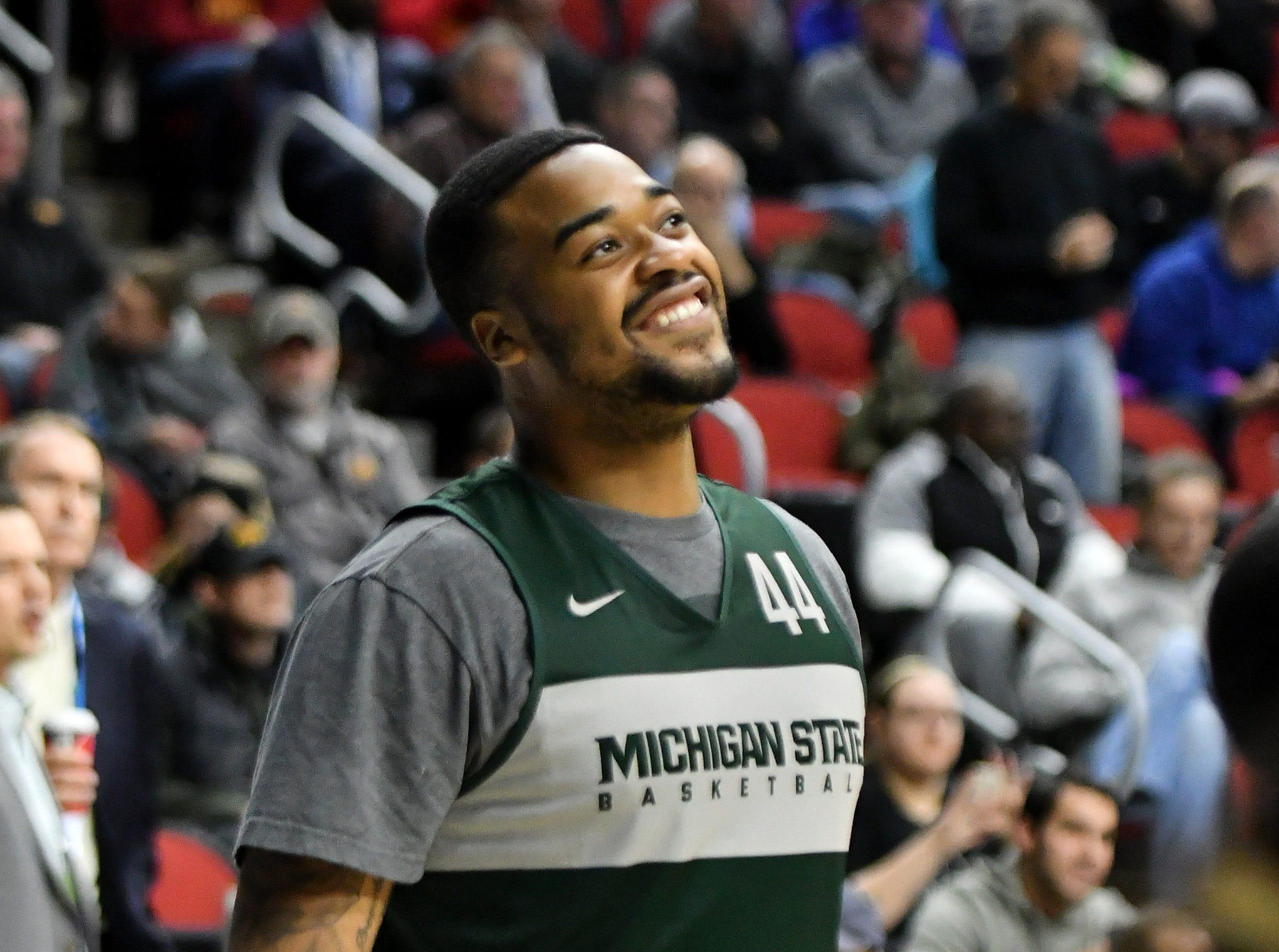 Michigan State forward Nick Ward smiles during practice.