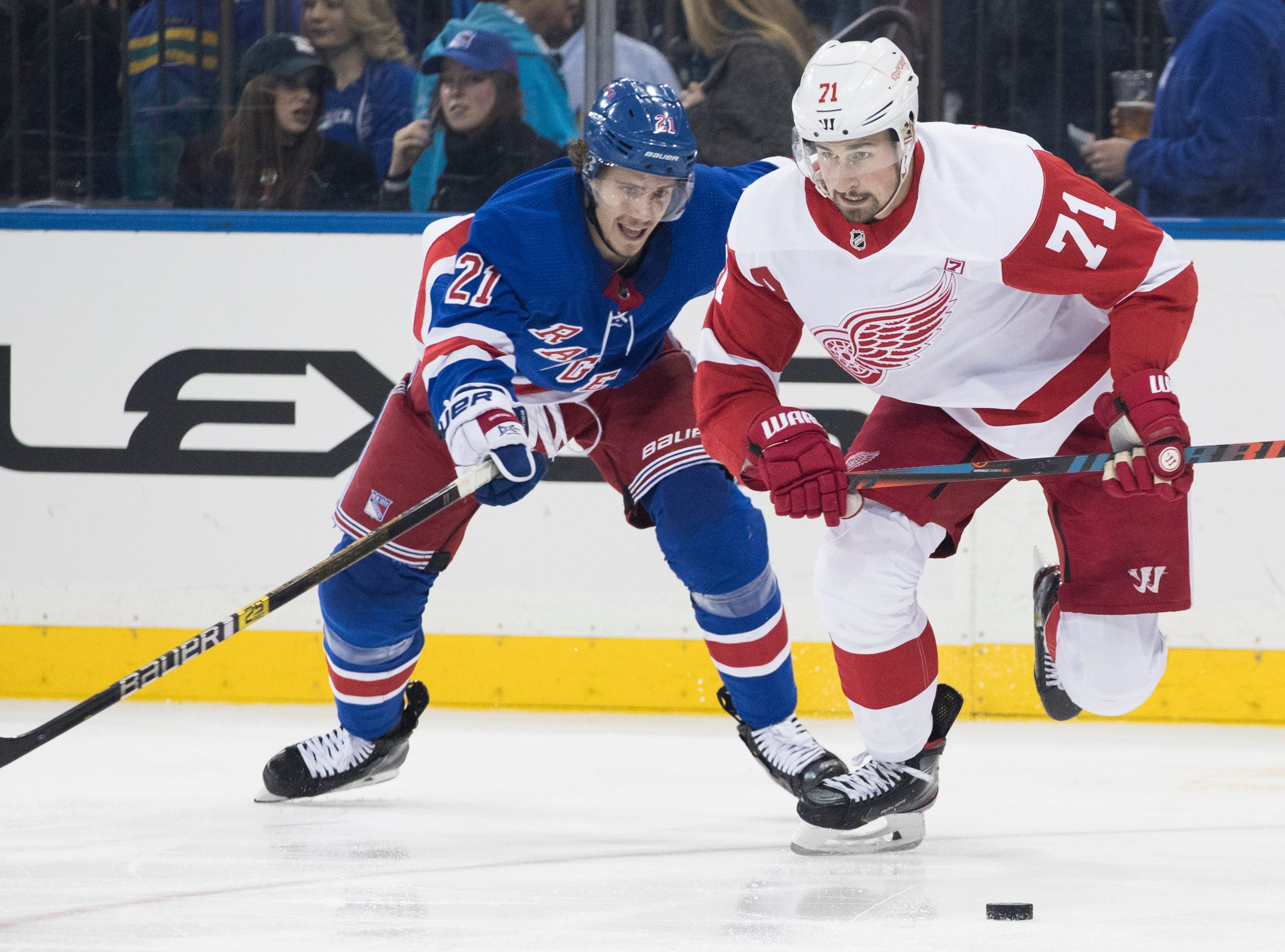New York Rangers center Brett Howden (21) and Detroit Red Wings center Dylan Larkin (71) fights for the puck during the second period.