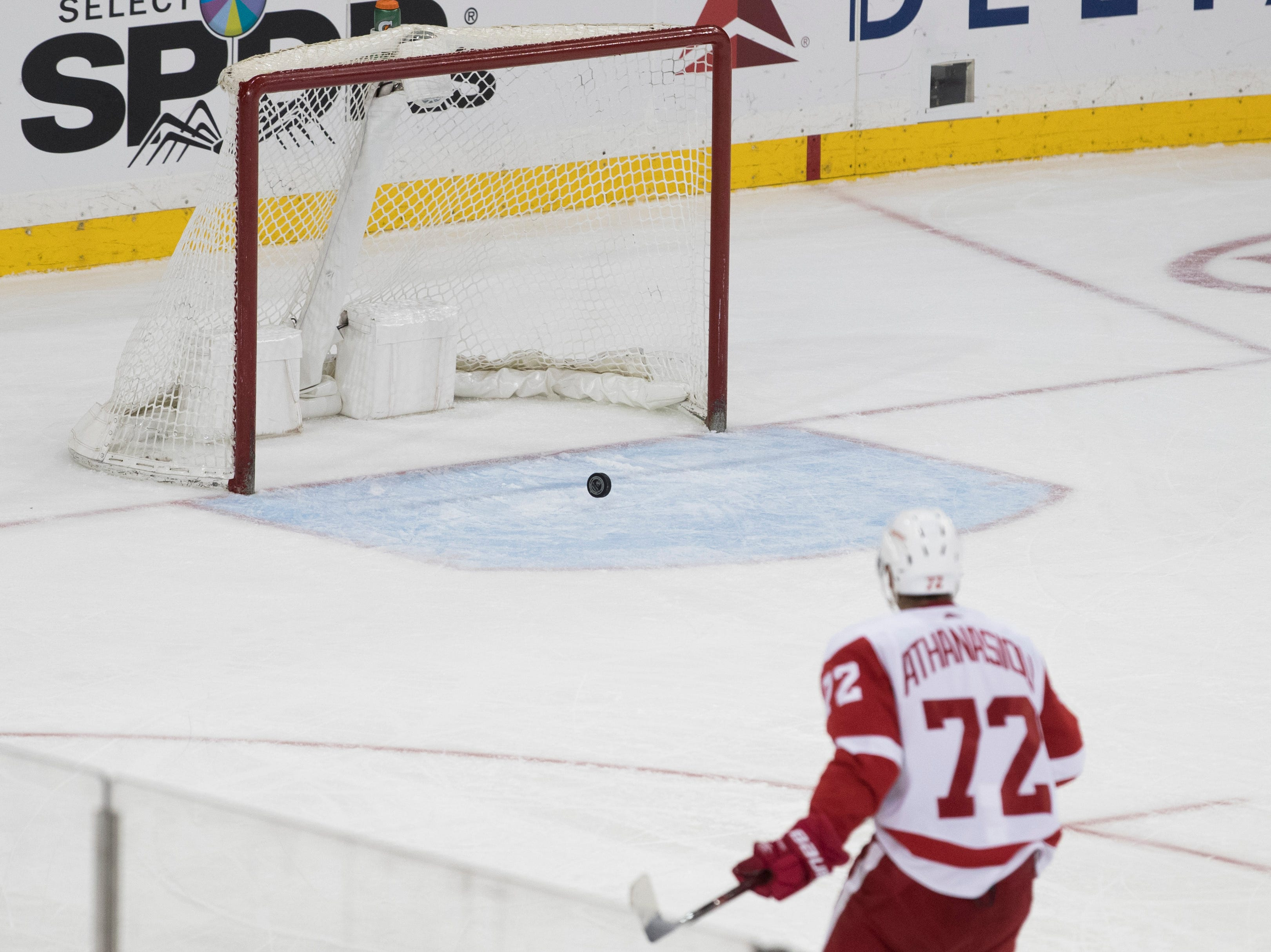 Detroit Red Wings center Andreas Athanasiou scores the winning goal during the third period.