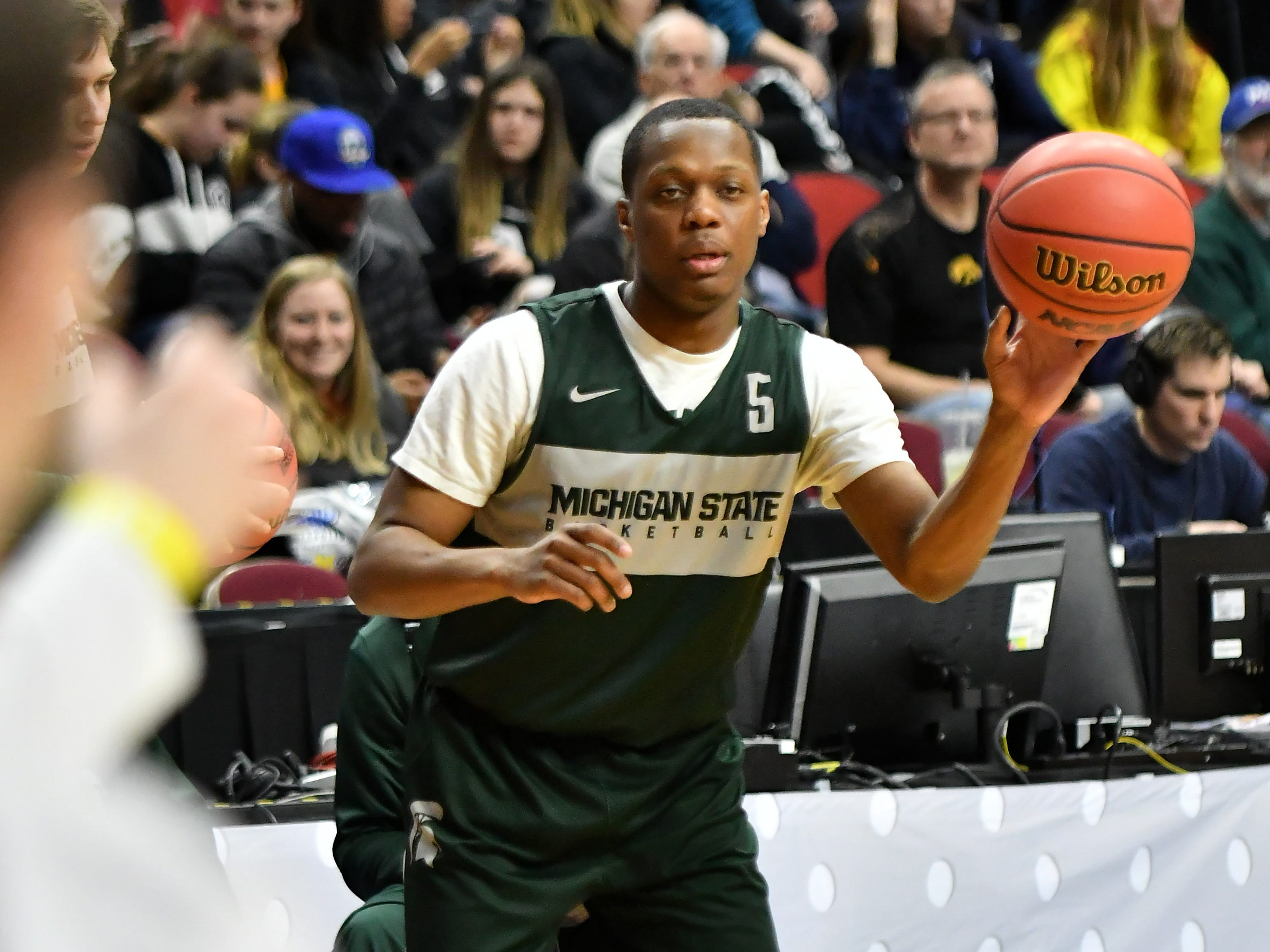 Michigan State guard Cassius Winston passes the ball during practice.