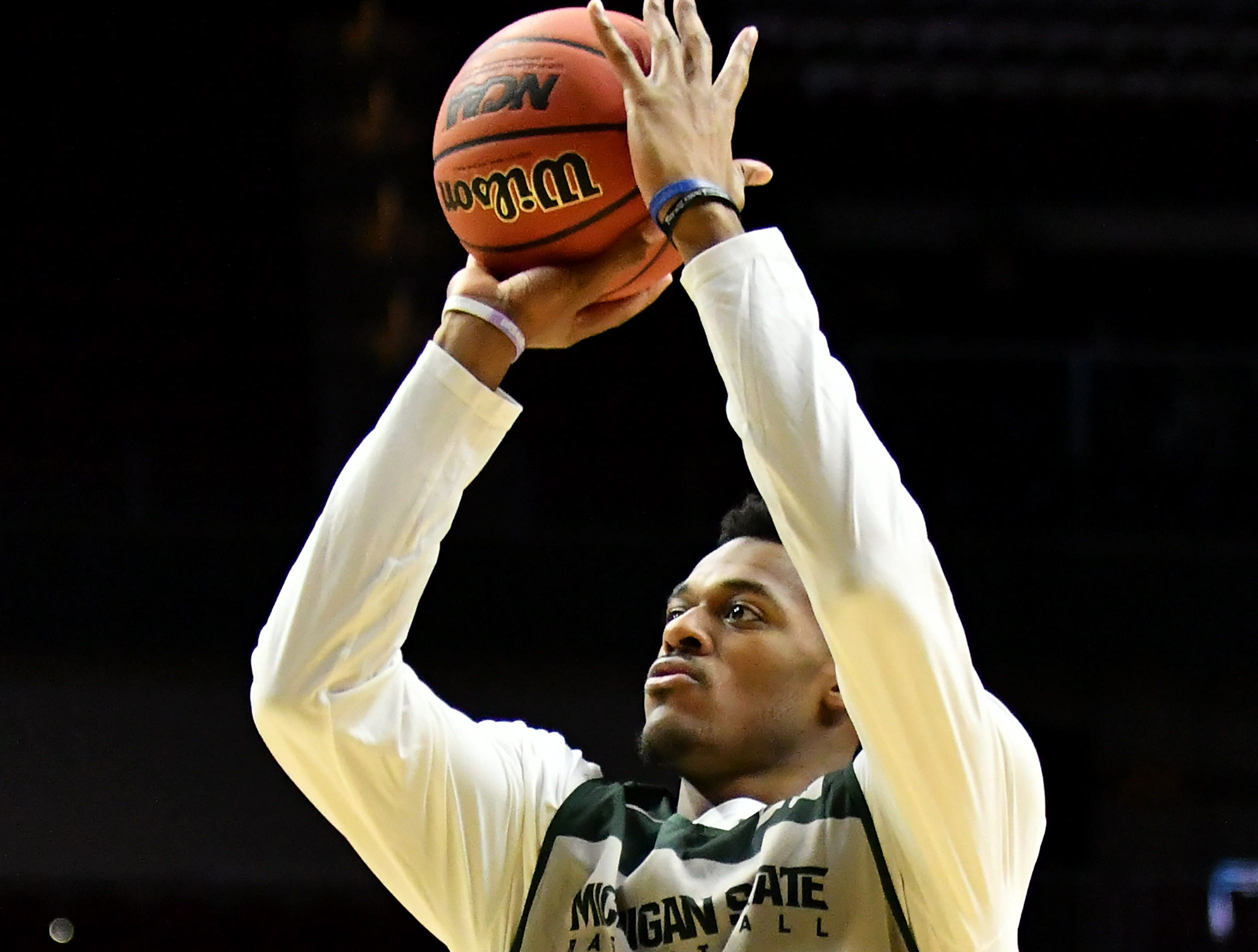 Michigan State forward Xavier Tillman (23) takes a shot during practice.