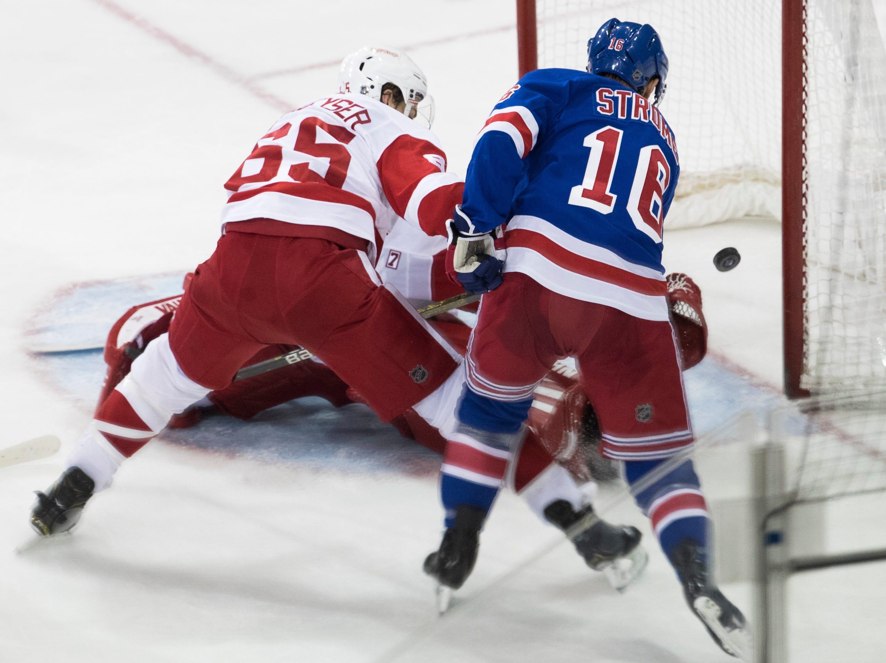 New York Rangers center Ryan Strome (16) scores a goal past Detroit Red Wings defenseman Danny DeKeyser (65) and goaltender Jimmy Howard during the third period.