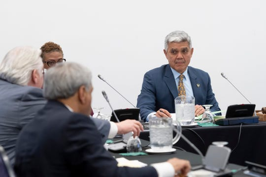 President of the Wayne State University Roy Wilson listens during a Board of Governors meeting at Wayne State University.