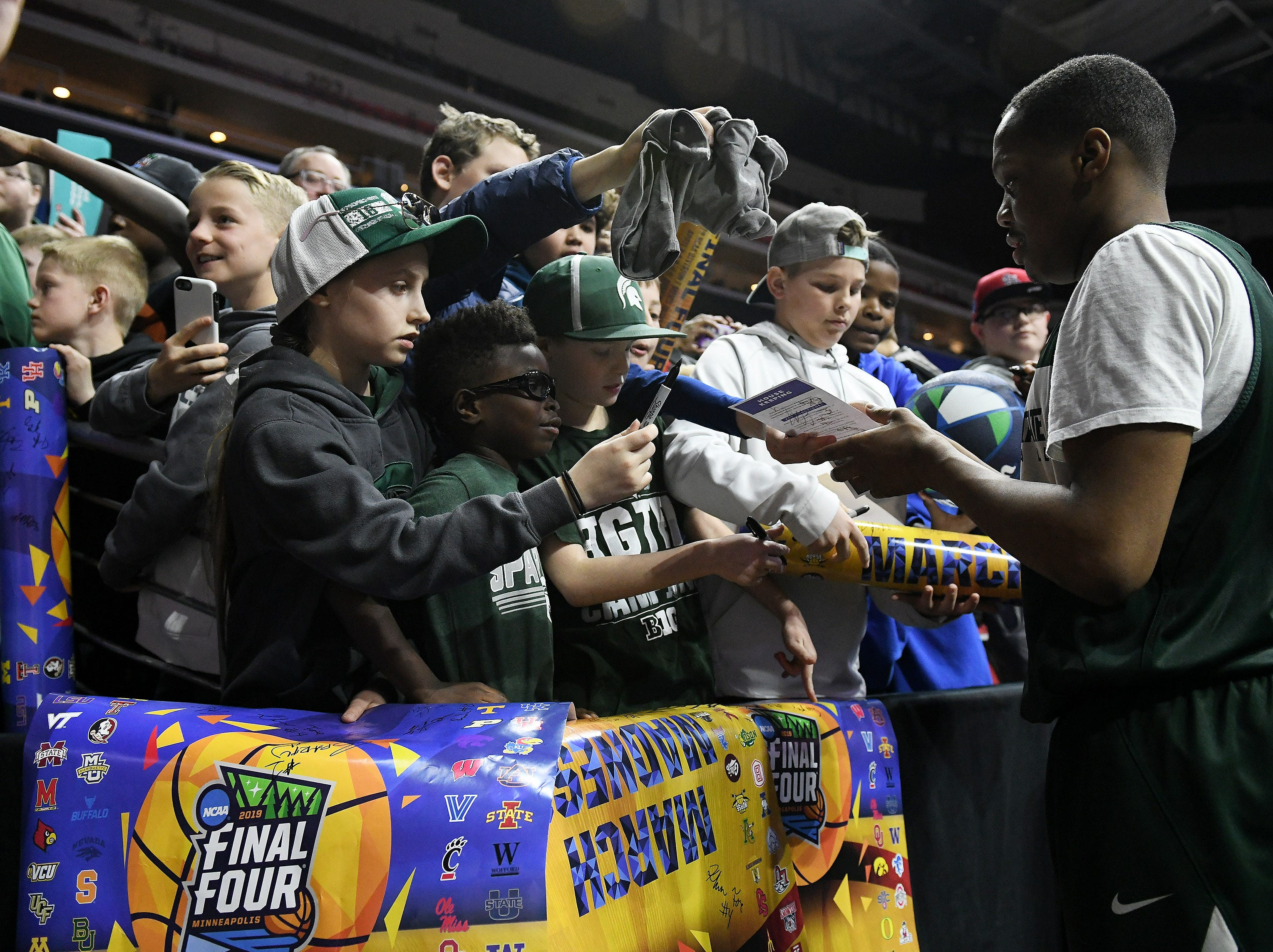 Michigan State guard Cassius Winston (5) signs autographs after Michigan State practice. Open practice day for Round 1 of the NCAA Tournament at Wells Fargo Arena in Des Moines, Iowa on March. 20, 2019.   