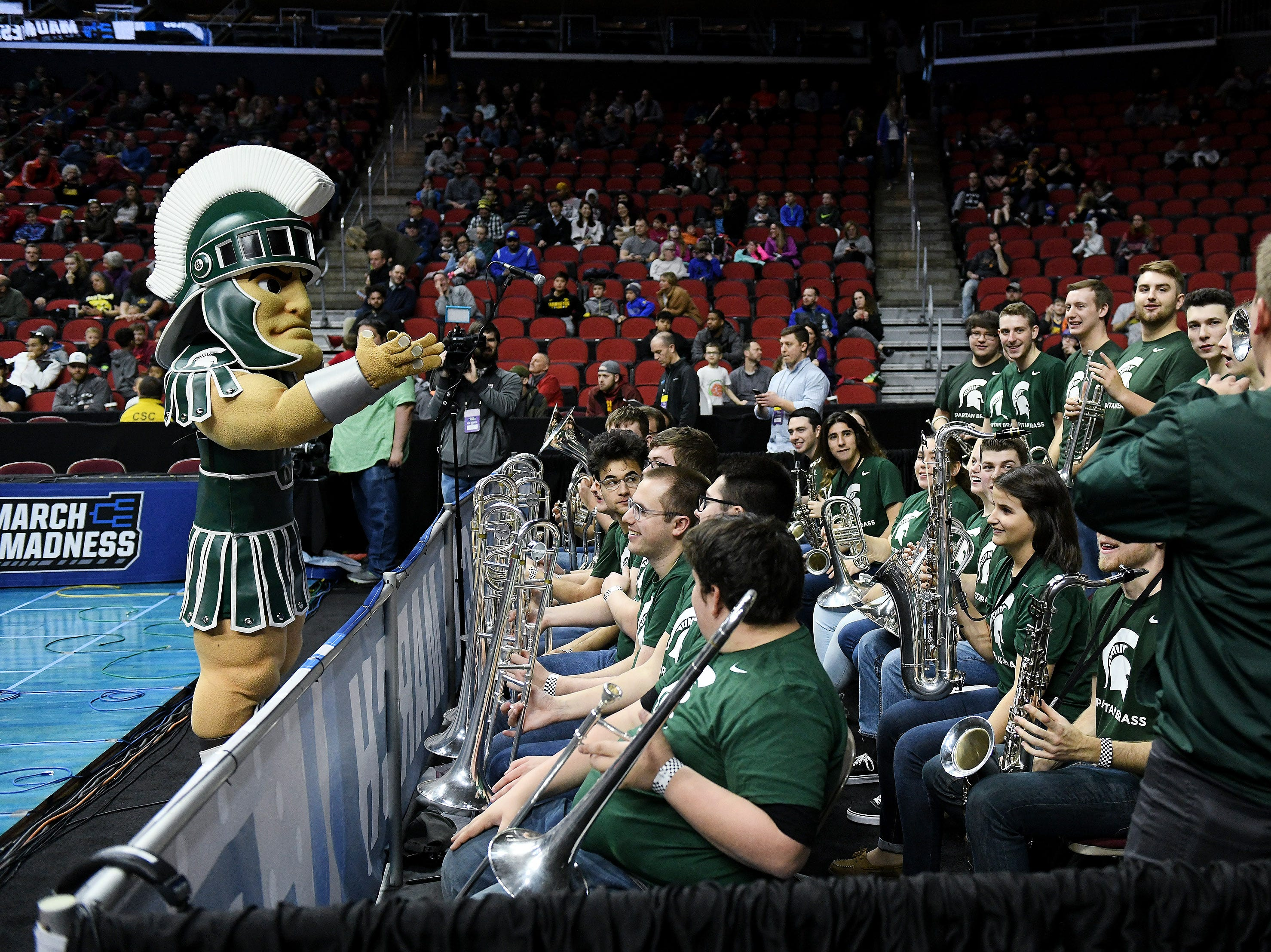 Sparty tries to lead the Michigan State band during the Spartans' practice.