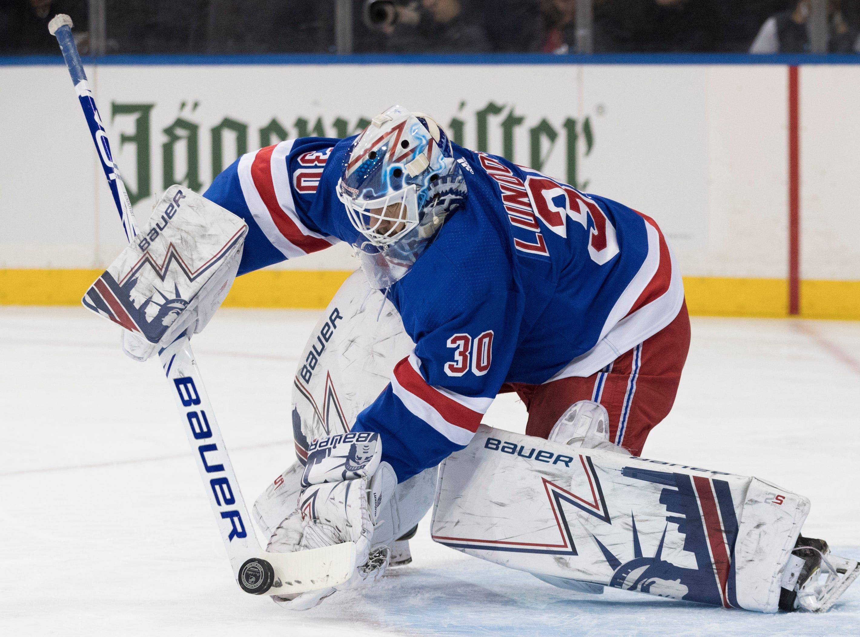 New York Rangers goaltender Henrik Lundqvist makes the save during the first period.