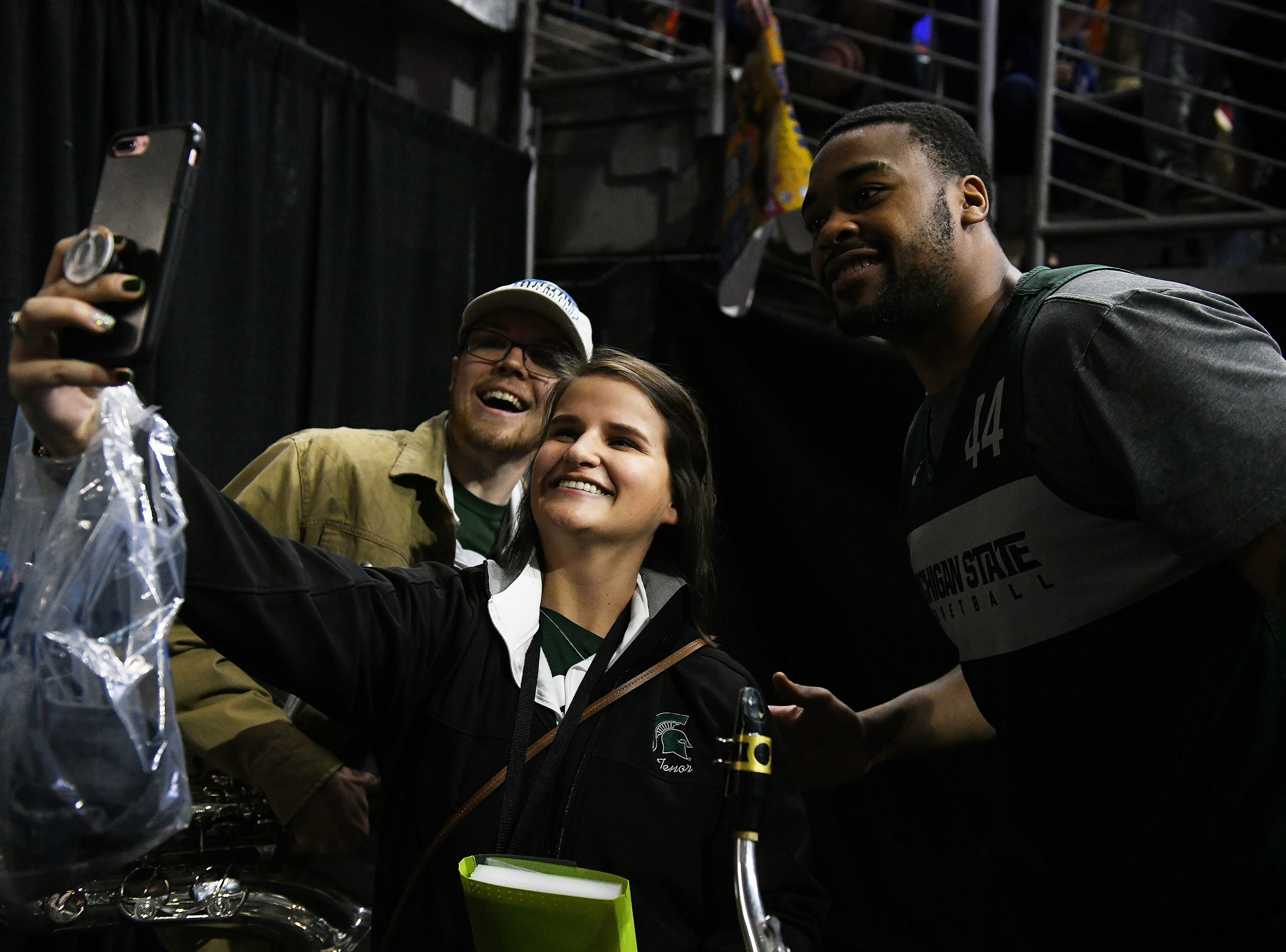 Michigan State forward Nick Ward stops to take a photo with band members, Taylor Even and Sven Adriaens, left, after Michigan State practice.