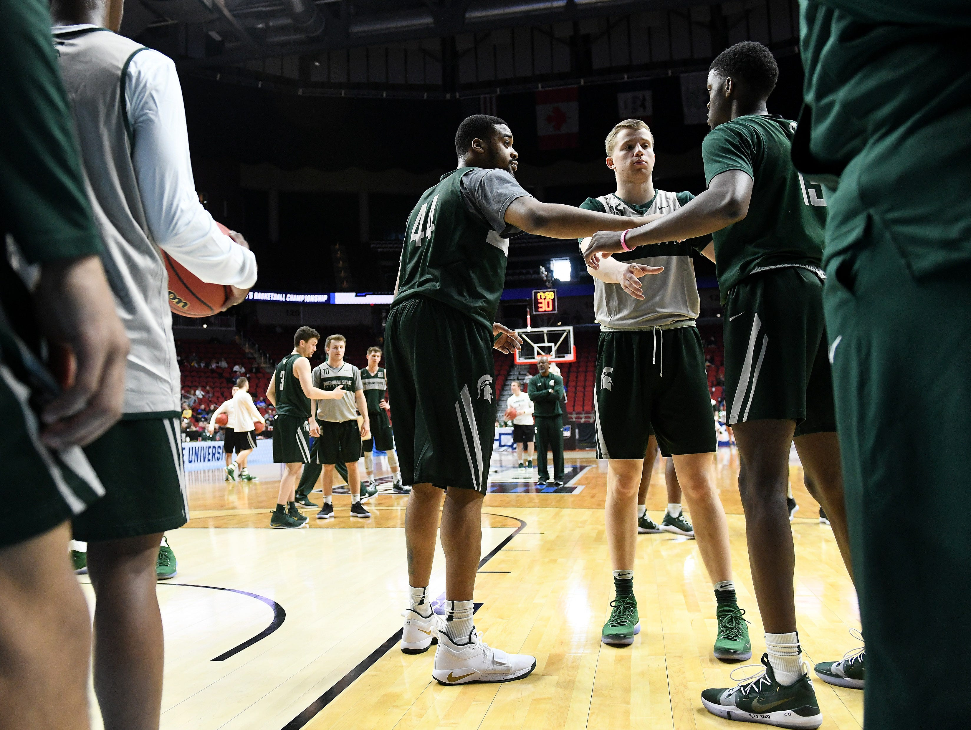 Michigan State forward Nick Ward (44), Thomas Kithier, center, and Michigan State forward Gabe Brown, right, walk through a drill during the Spartans' practice in Iowa.