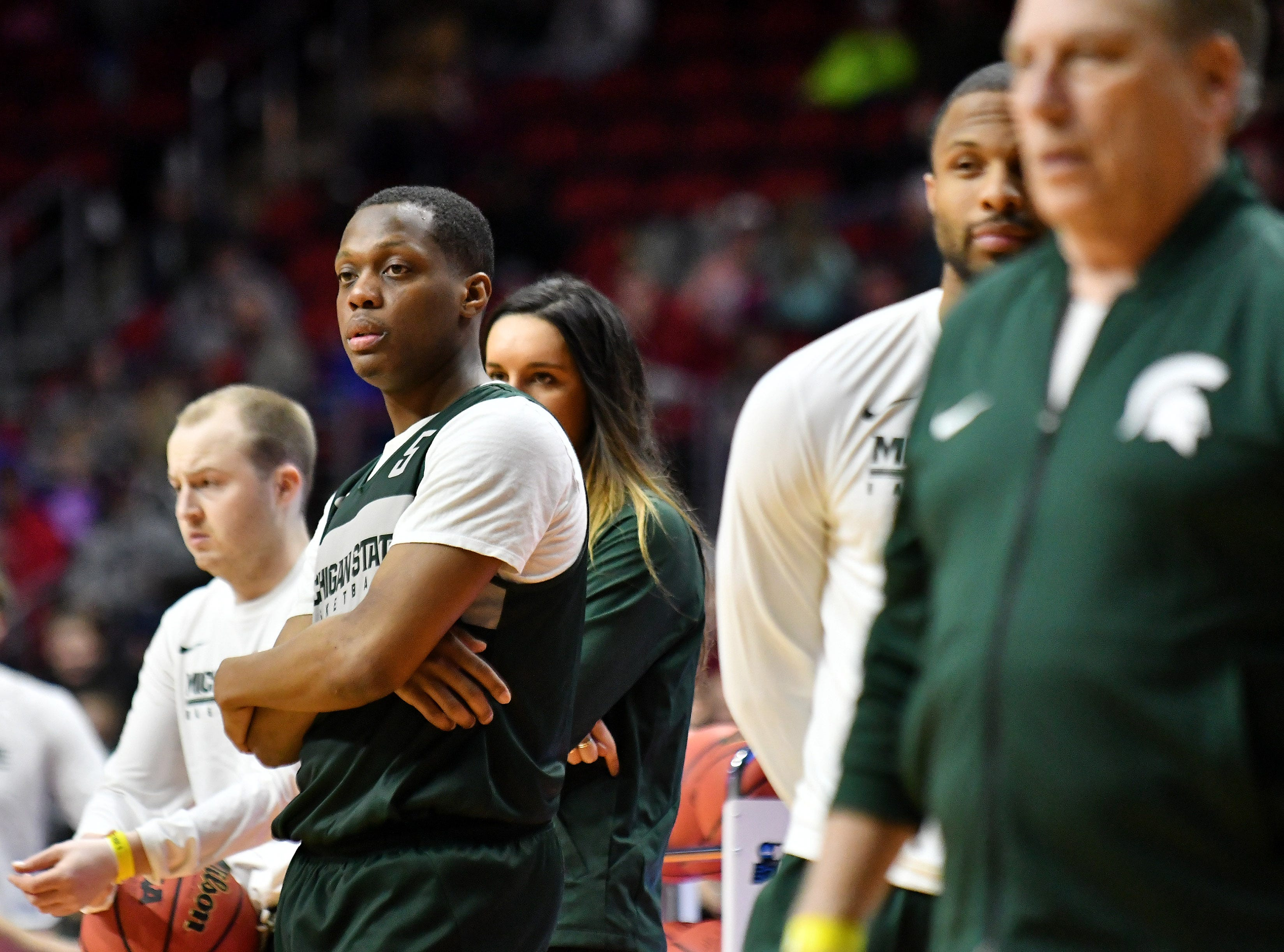 Michigan State guard Cassius Winston watches teammates during drills.