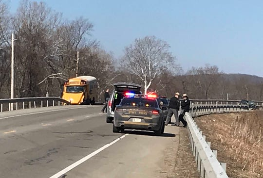 New York State Police investigate a crash that killed an Addison woman who struck an Addison Central School District bus head-on in the Town of Erwin on Wednesday, March 20, 2019.