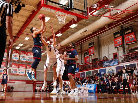 Mateo Rivera attempts a layup during USI's regional championship win over rival Bellarmine, 76-69.